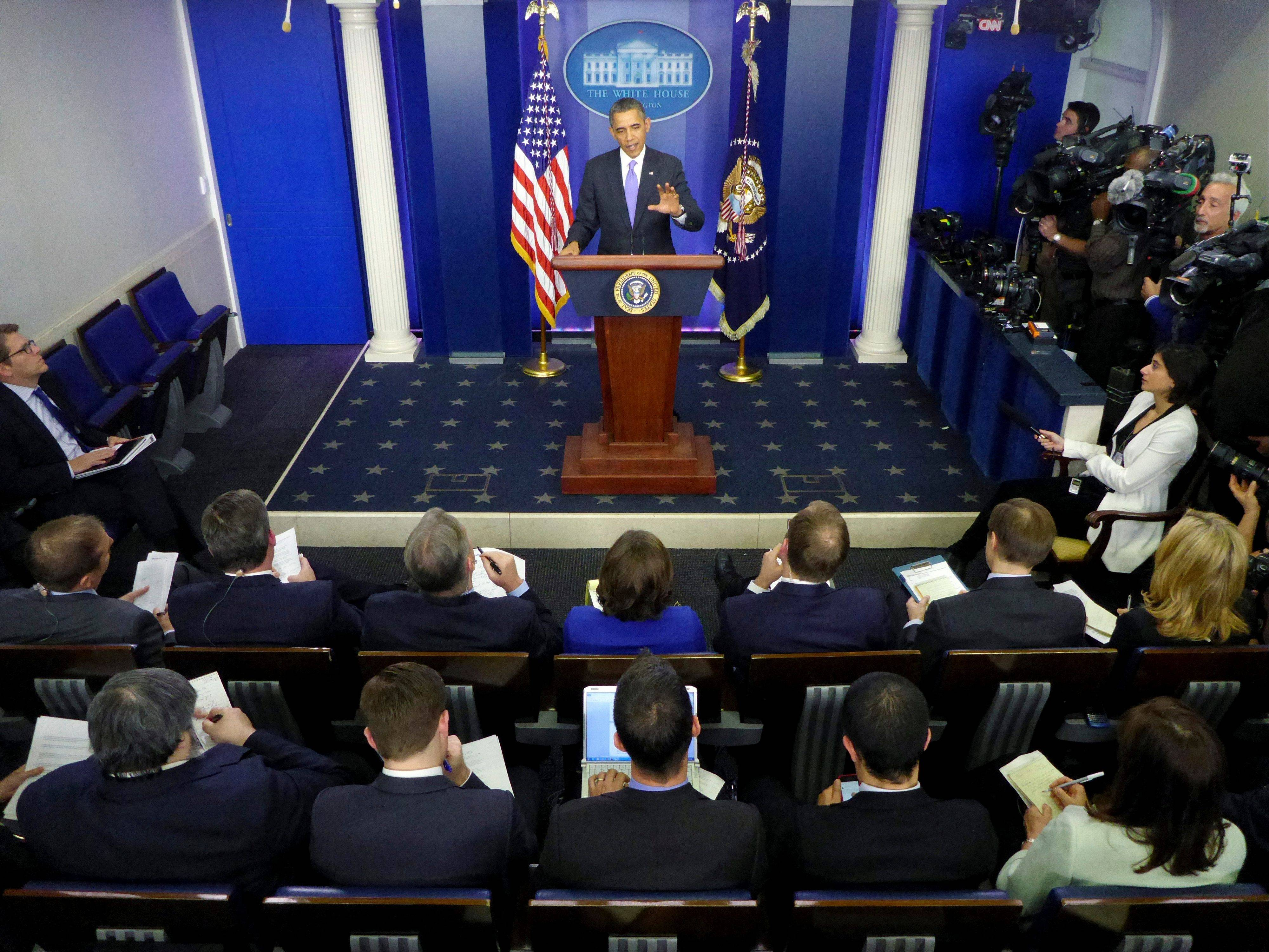 President Barack Obama speaks during his end-of-the-year news conference Friday in the Brady Press Room at the White House in Washington.