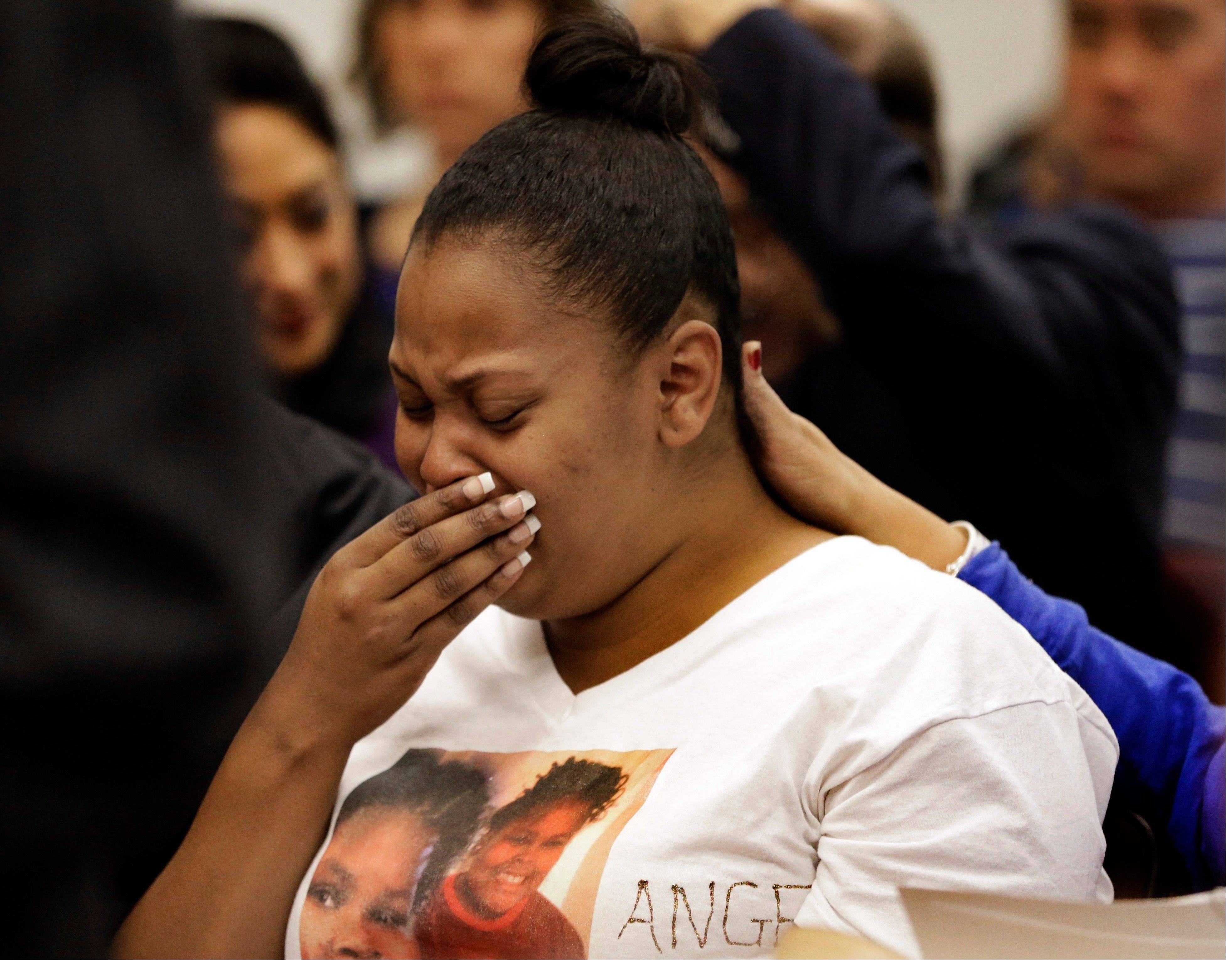 Nailah Winkfield, mother of 13-year-old Jahi McMath, cries before a courtroom hearing Friday regarding McMath, in Oakland, Calif. McMath remains on life support at Children's Hospital Oakland nearly a week after doctors declared her brain dead.