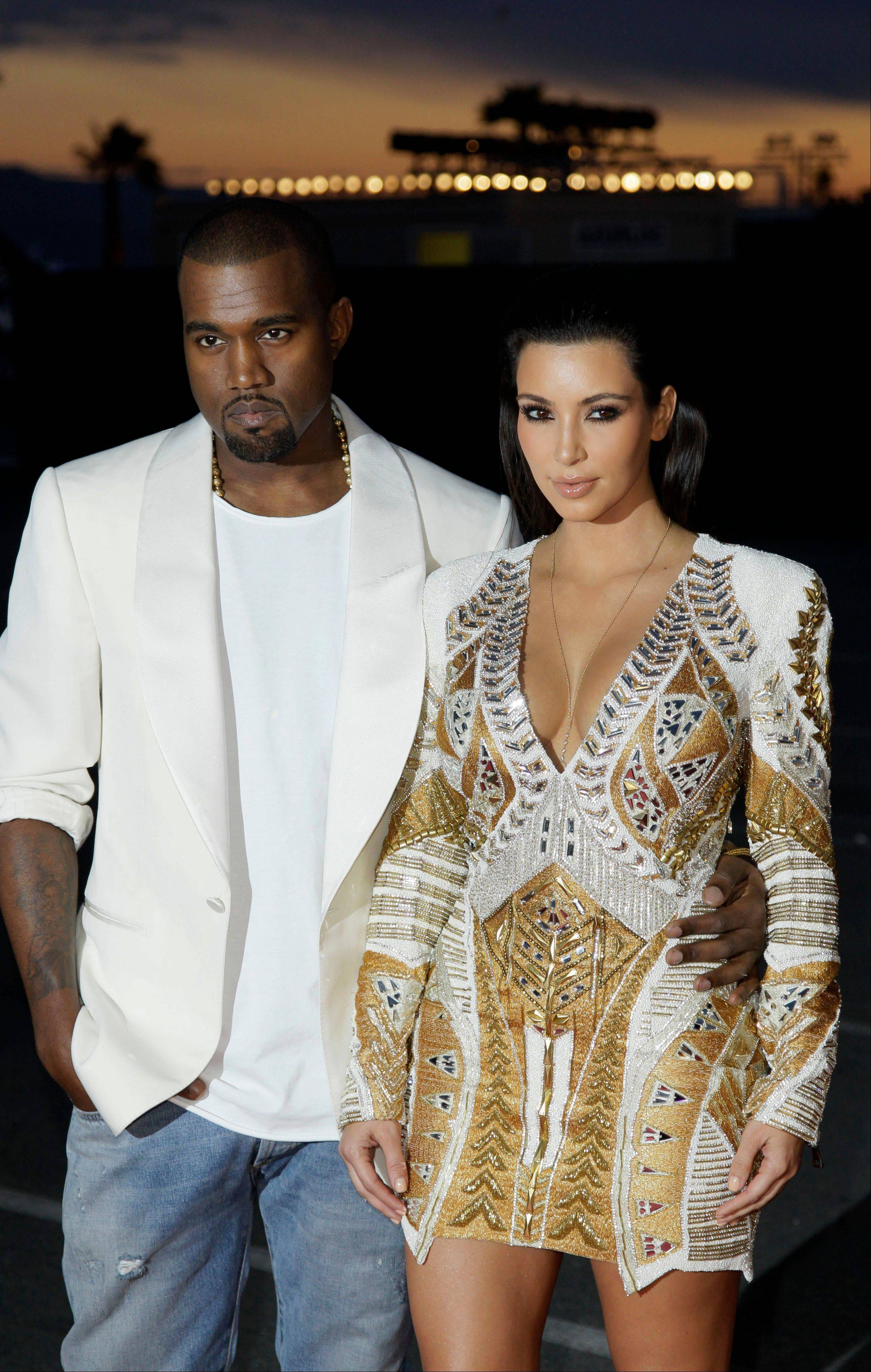 "Kanye West, left, and television personality Kim Kardashian arrive for the screening of ""Cruel Summer"" at the 65th international film festival, in Cannes, southern France. West had many righteous things to rage about in 2013, from the fashion industry not giving him credit for brilliant, life-changing designs like leather jogging pants to not getting respect from President Barack Obama."