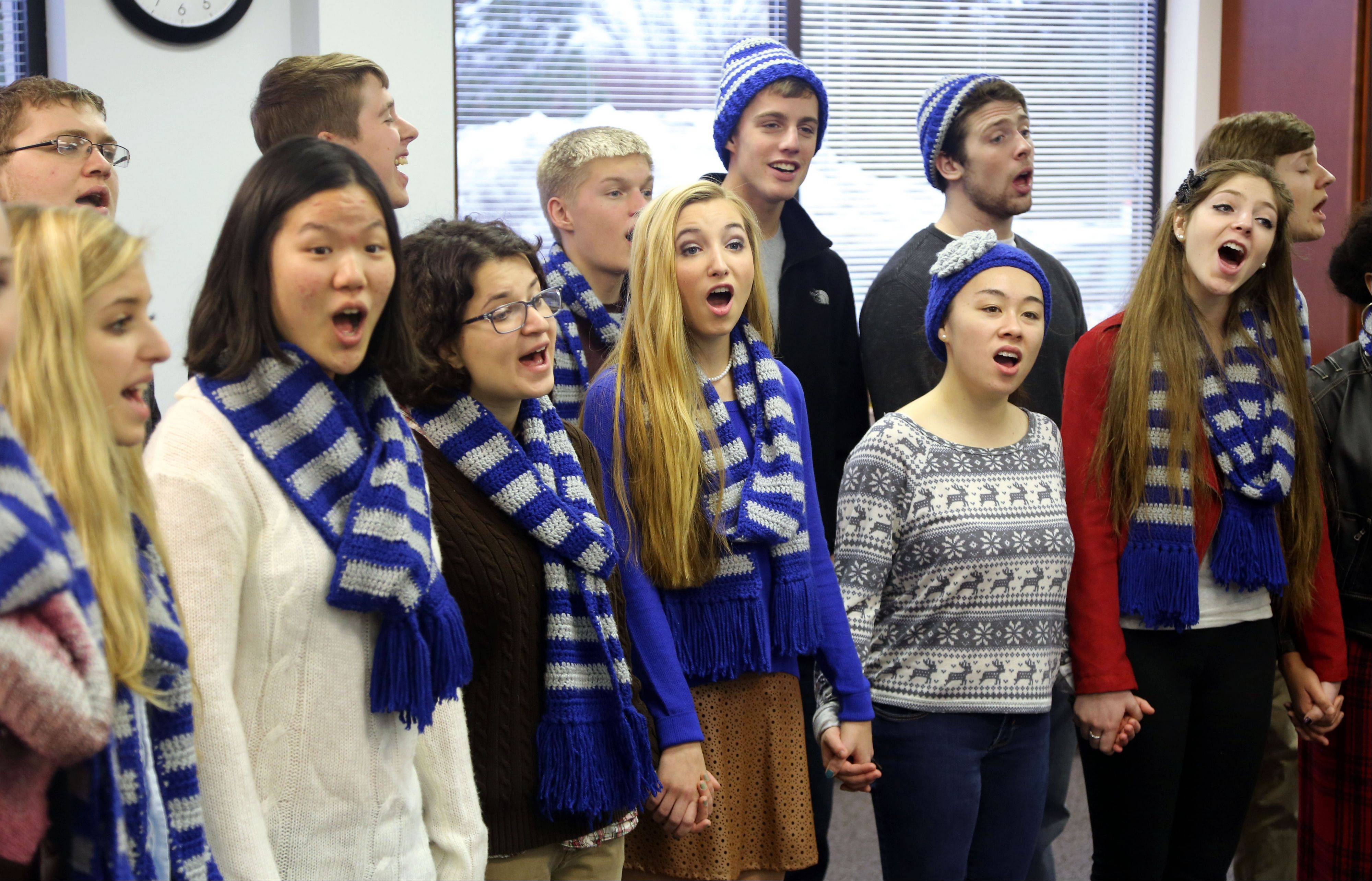 The Vernon Hills High School chamber choir performs Christmas carols for the Libertyville-Vernon Hills Area High School District 128 office Friday in Vernon Hills.