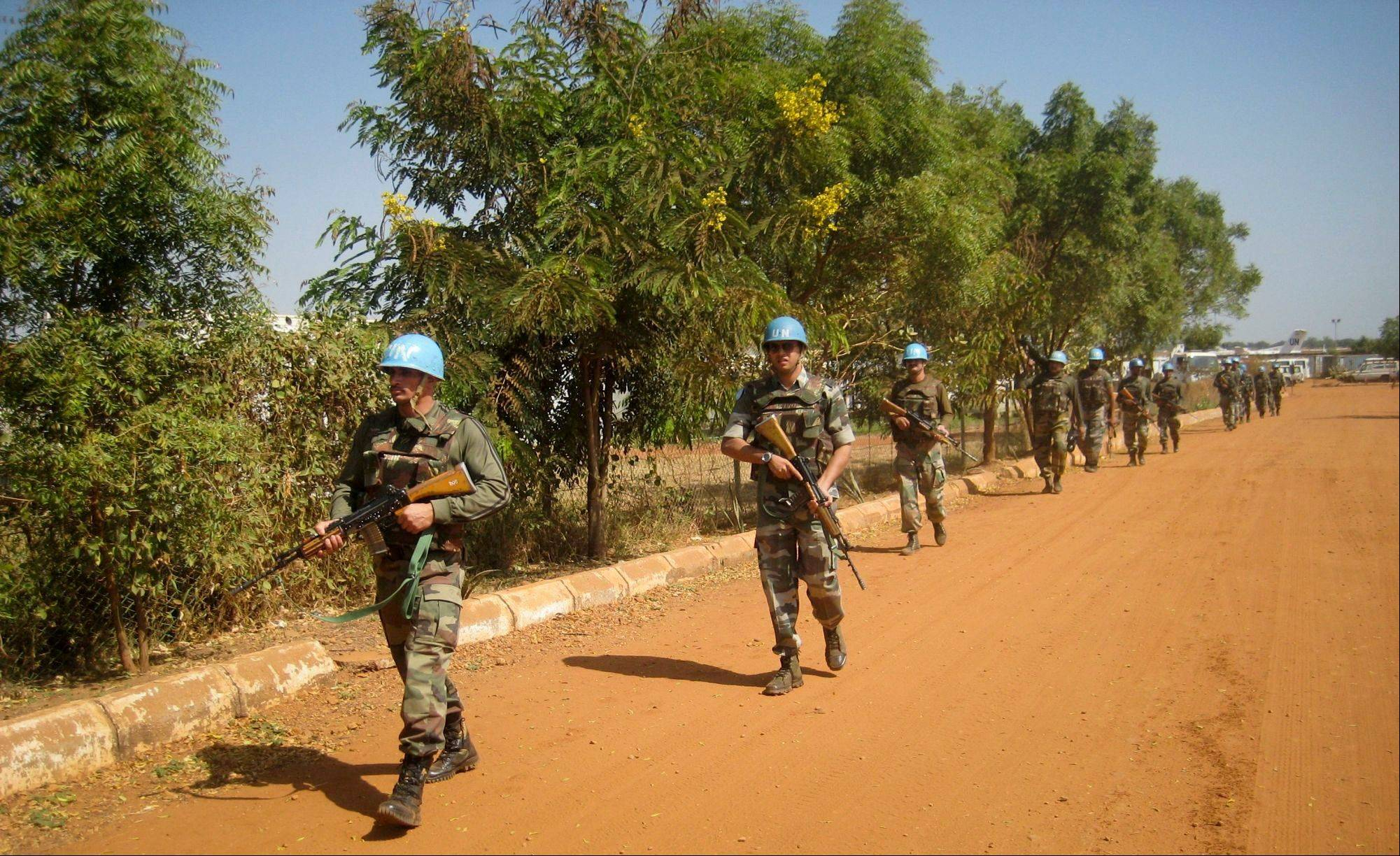 U.N. troops from India patrol at the compound in Juba, South Sudan. The U.N.'s humanitarian arm said Friday that 34,000 people in South Sudan are seeking refuge at U.N. bases in three locations across the country.