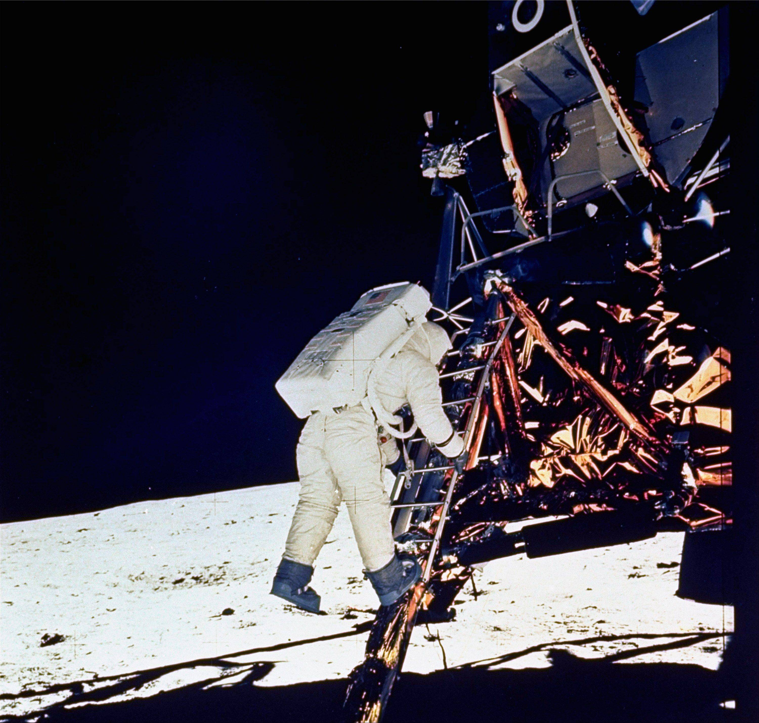 "In this July 20, 1969, file photo, Astronaut Edwin E. ""Buzz"" Aldrin, Jr., lunar module pilot, descends the steps of the Lunar Module ladder as he prepares to walk on the moon."