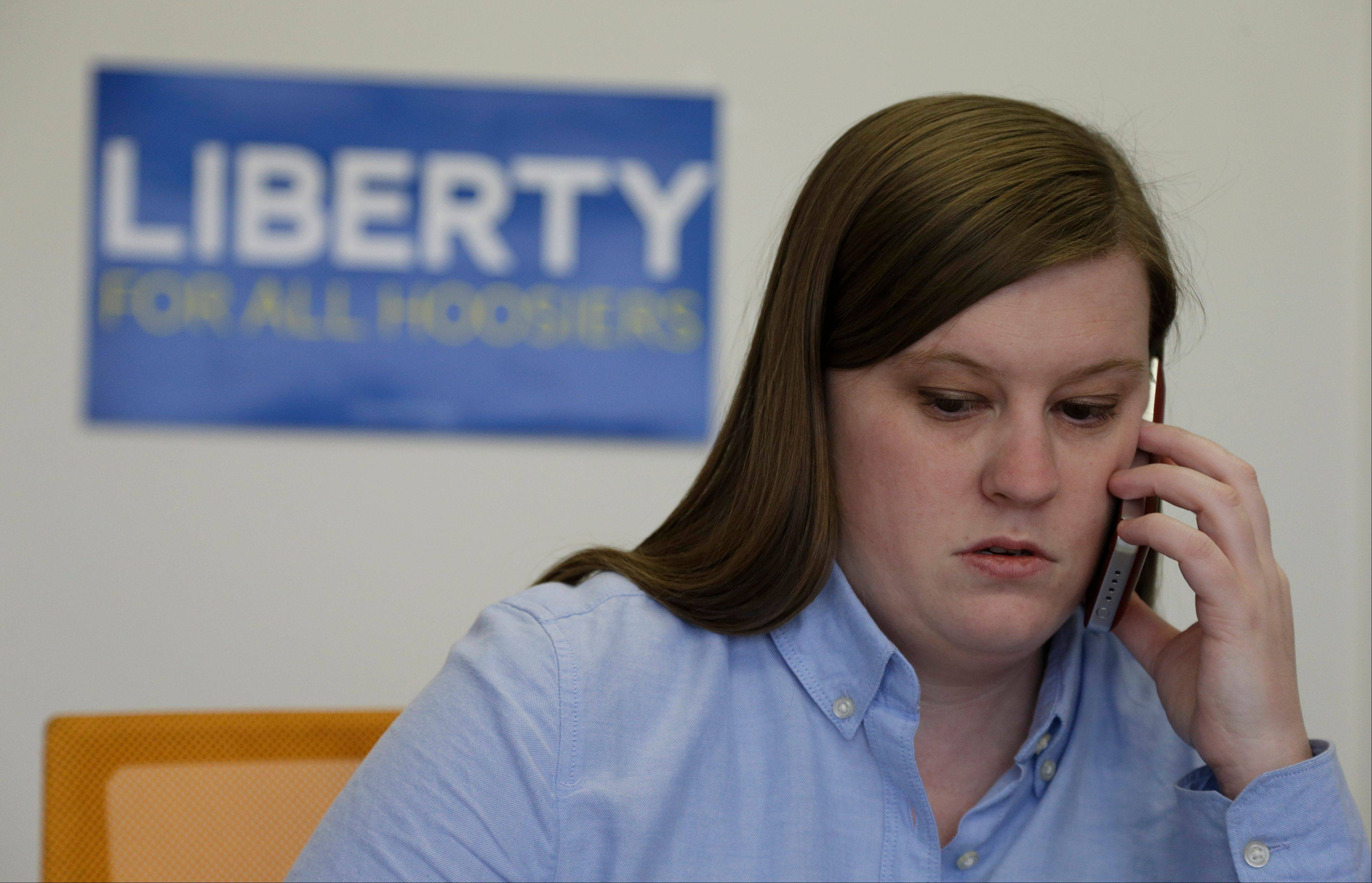 Megan Robertson, campaign manager for Freedom Indiana, makes a phone call in Indianapolis. Indiana lawmakers will decide whether to ask voters to amend the constitution to ban same-sex marriage when they reconvene in January.