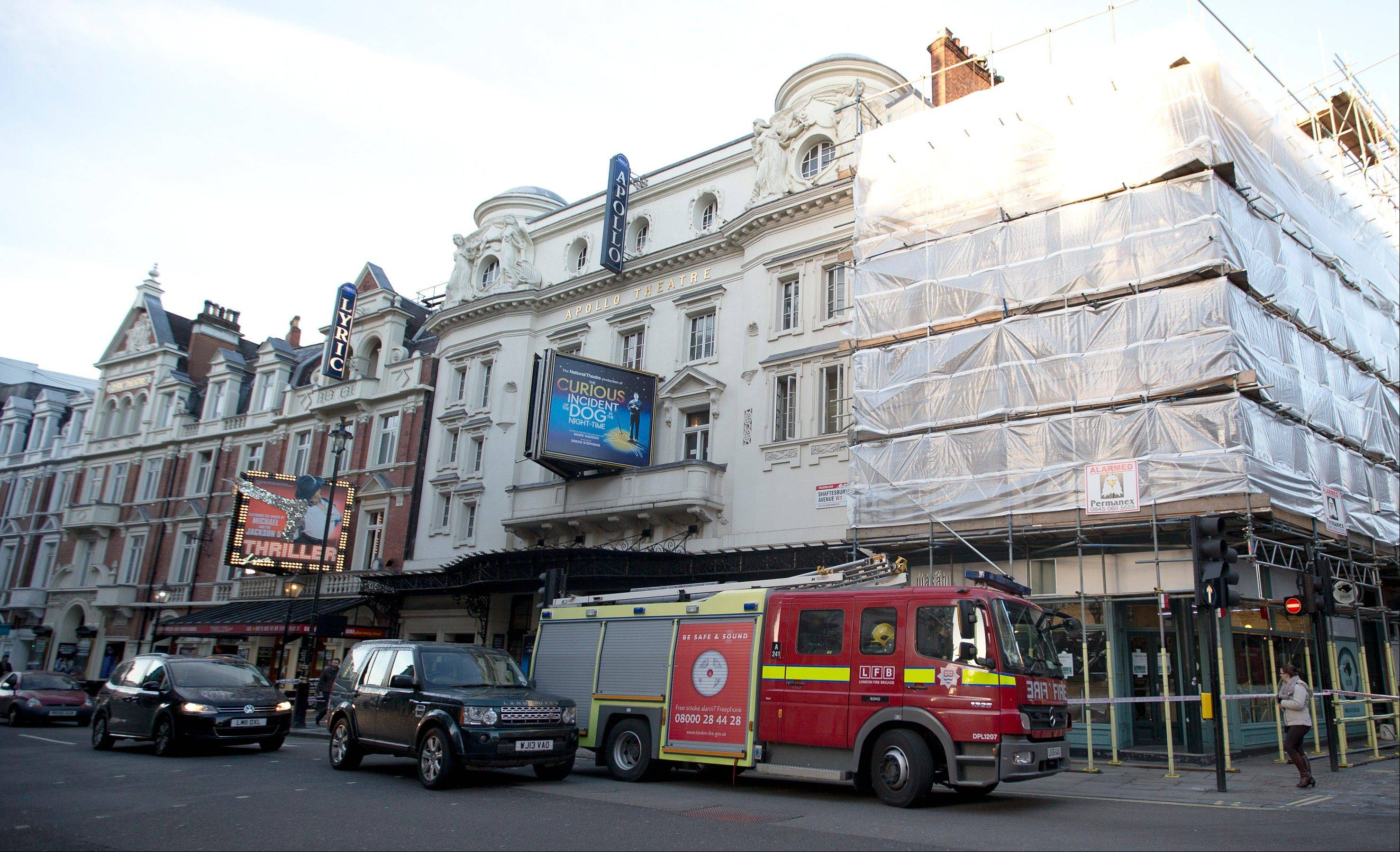 A fire brigade truck waits outside The Apollo Theatre in London, Friday, Dec. 20, 2013. Authorities are carrying out a structural assessment at the Apollo Theatre after the partial collapse of its ceiling injured more than 75 people in the packed auditorium.