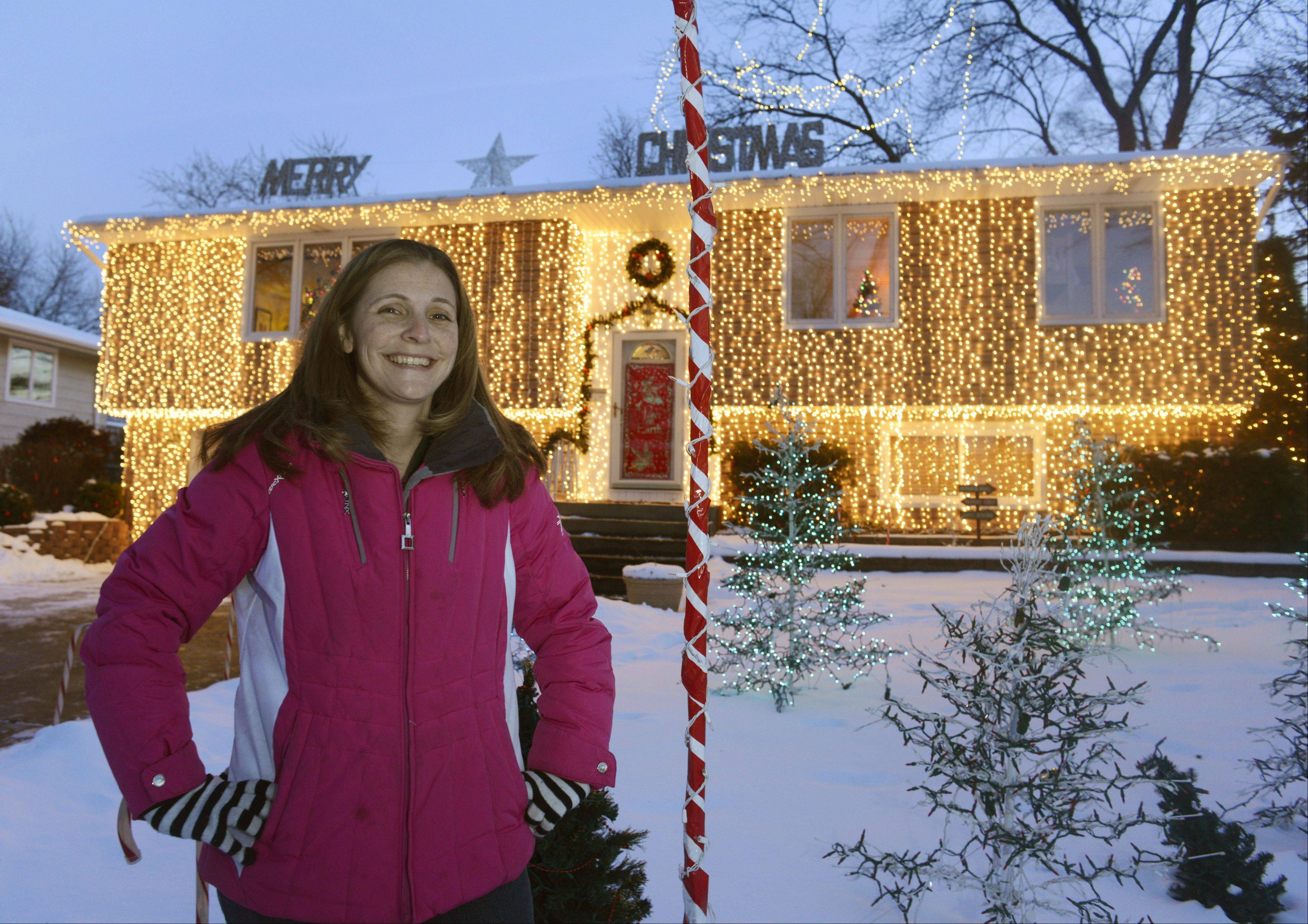 Heather Schluckbier of 503 Dartmouth Lane in Schaumburg is the winner of the Daily Herald Holiday Lights contest. She said winning a contest like this takes a lot of love for the holidays and a little bit of craziness.