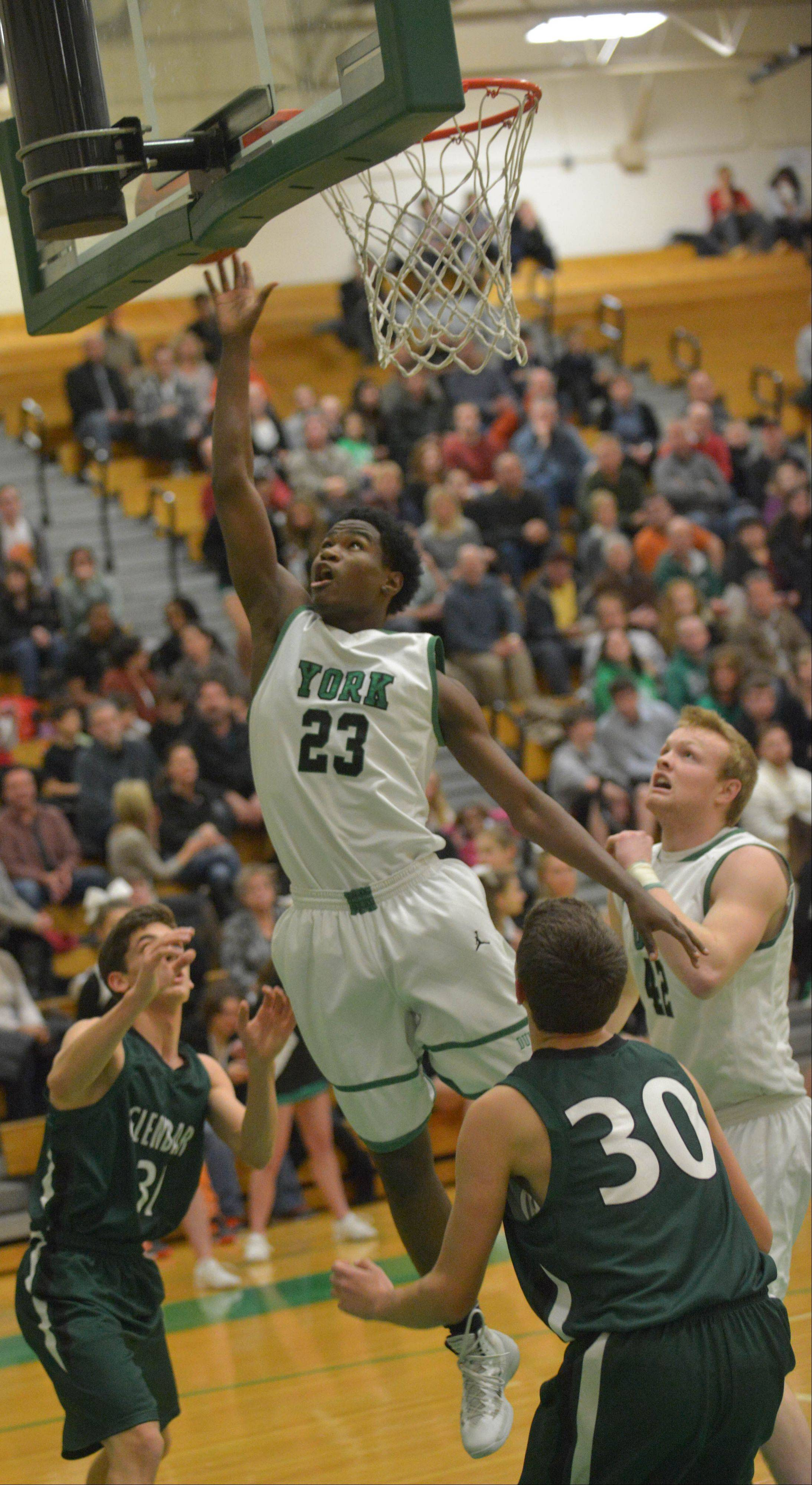 Jayvon Thomas of York takes one to the net during the Glenbard West at York boys basketball game Friday.