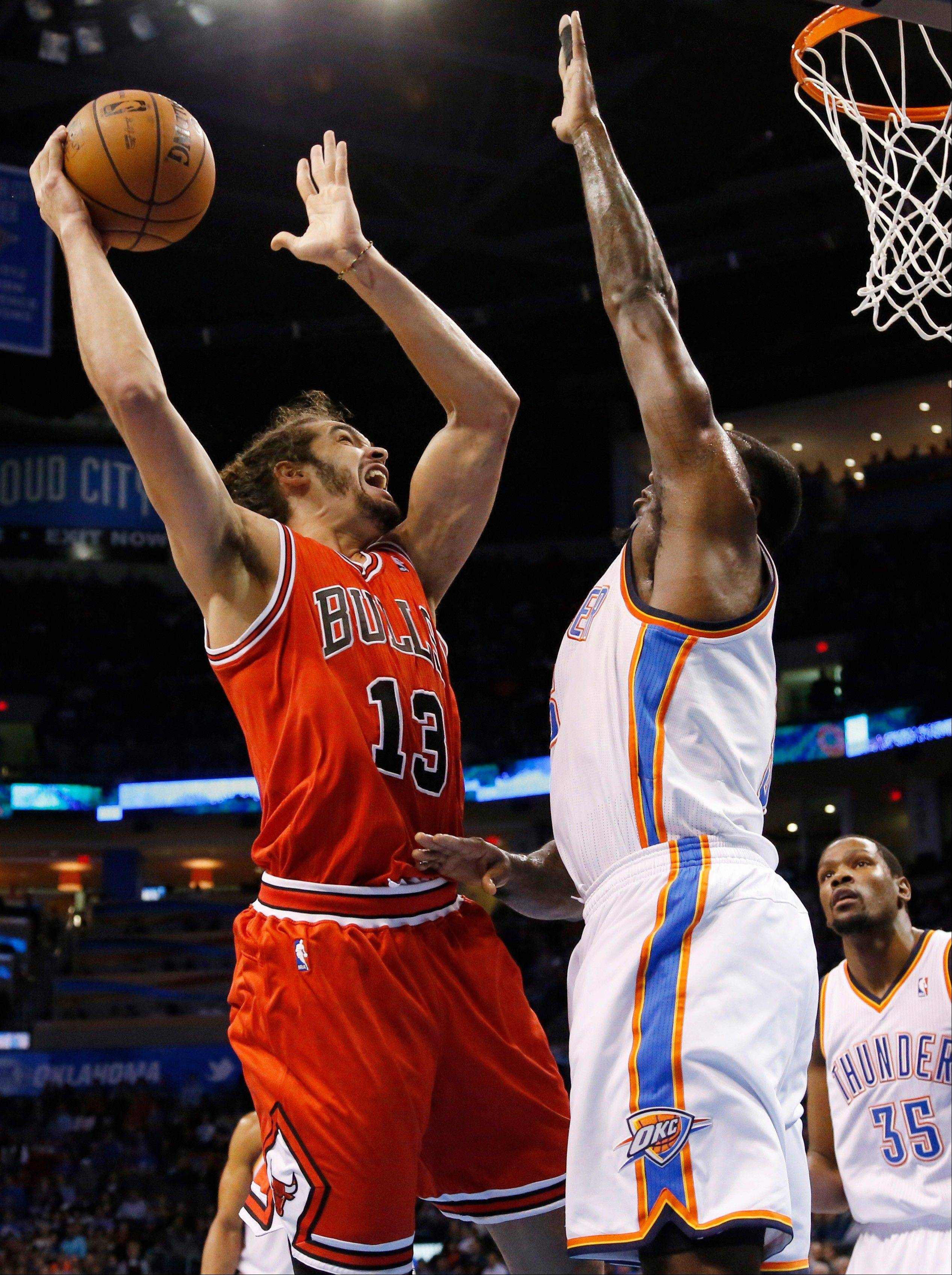 The Bulls' Joakim Noah is guarded by the Thunder's Kendrick on Thursday. After the game, Noah was visiting tormer teammate Thabo Sefolosha in the Thunder locker room when Perkins complained loudly about Noah's presence.