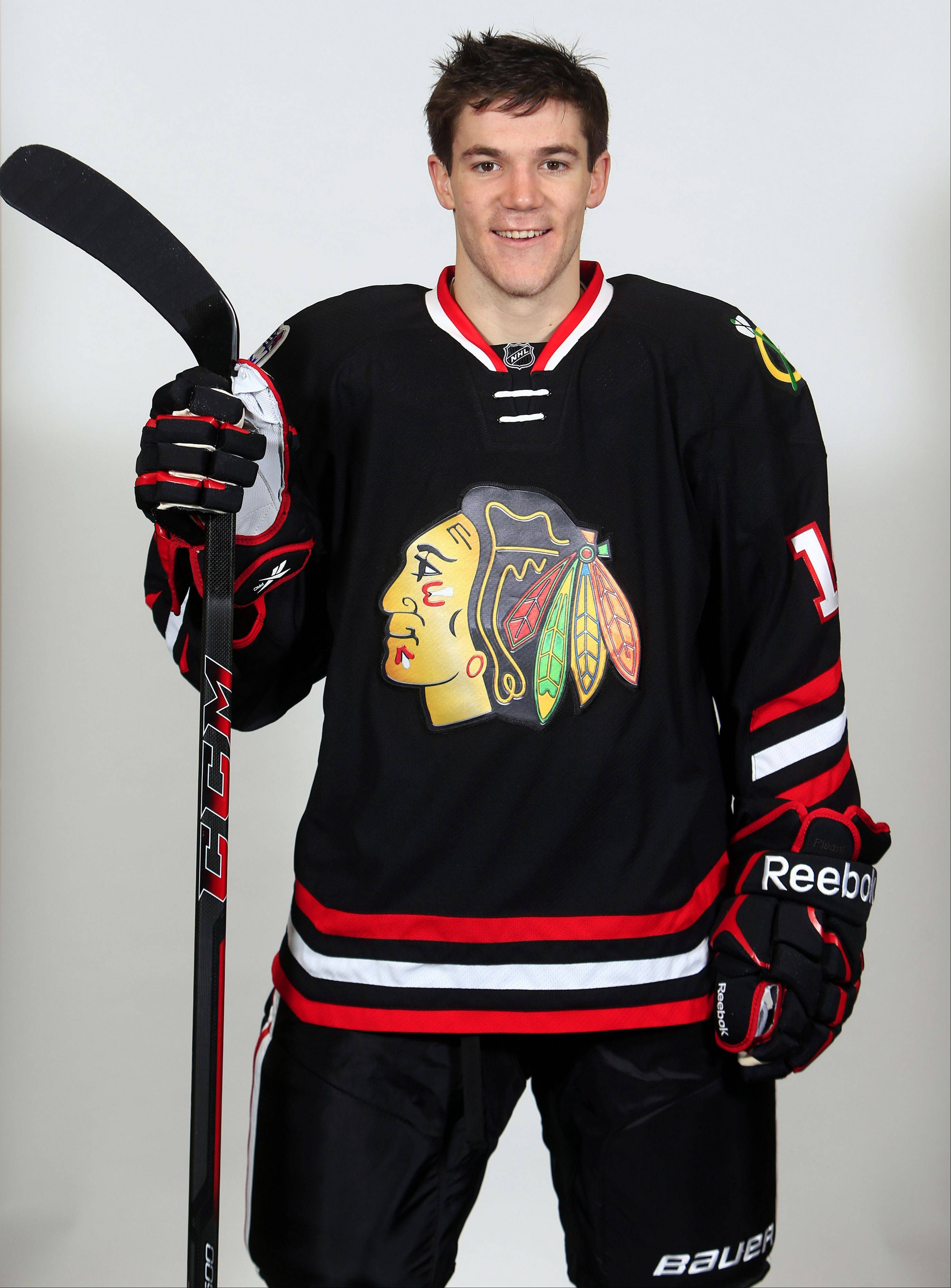 Photo courtesy of Chicago Blackhawks Andrew Shaw models the new Blackhawks jersey the team will wear for its March 1 game vs. the Pittsburgh Penguins at Soldier Field. The jersey features chrome-treated logo designs.