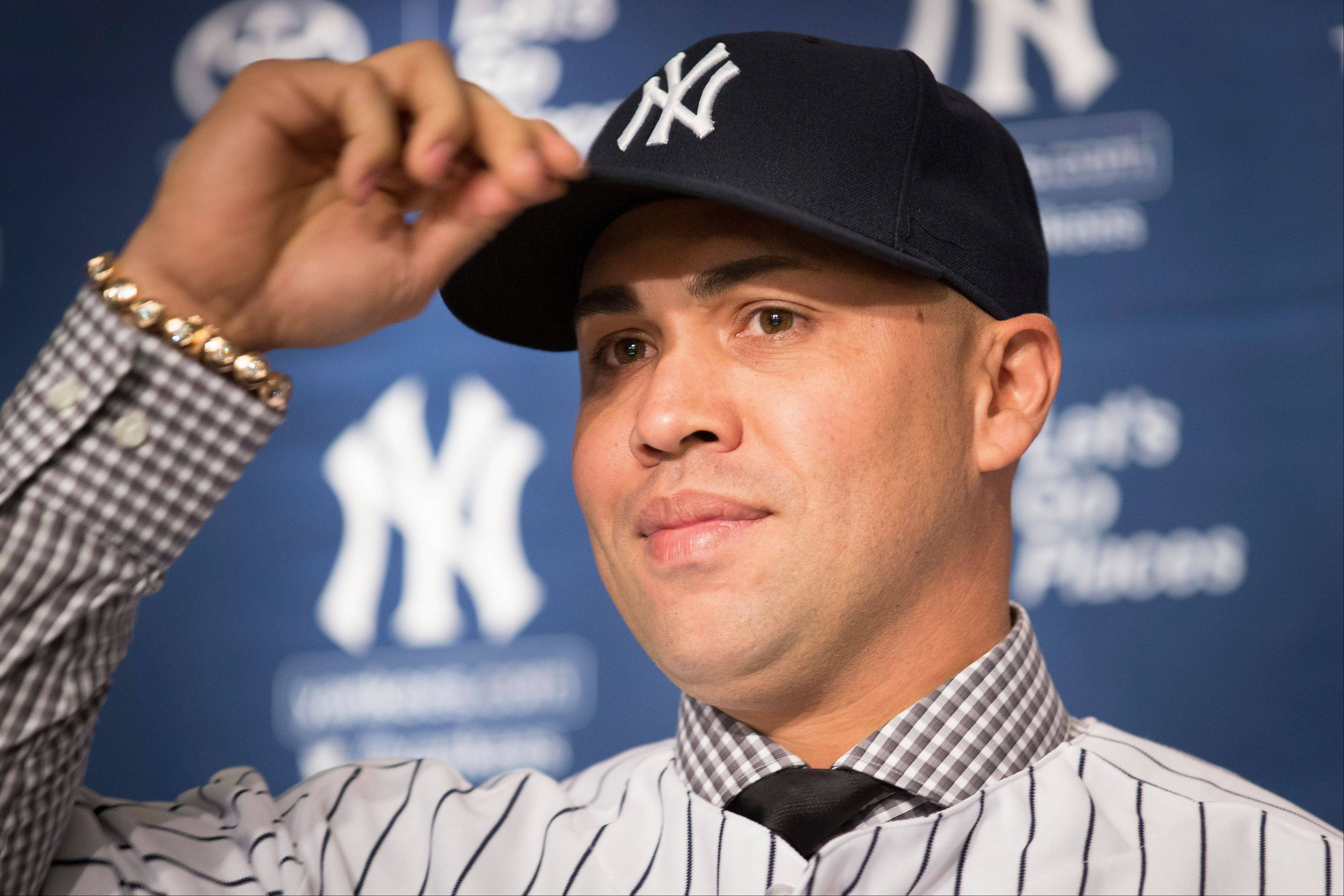 Outfielder Carlos Beltran signed with the New York Yankees for $45 million over three years.