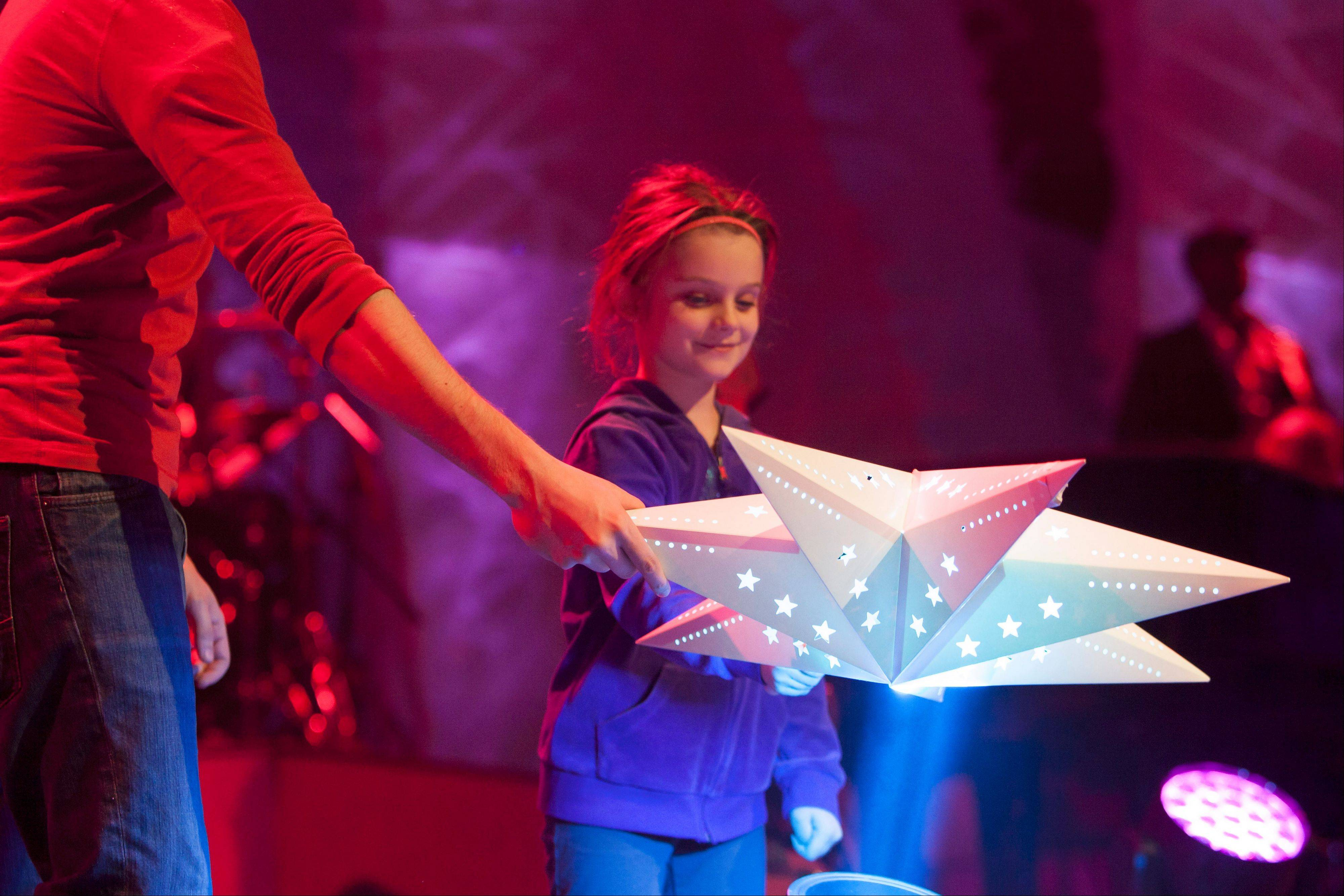 Cameryn Johnson, 5, will be among the many performers taking part in Christmas services at Willow Creek Community Church in South Barrington. More than 75,000 worshippers are expected to attend.