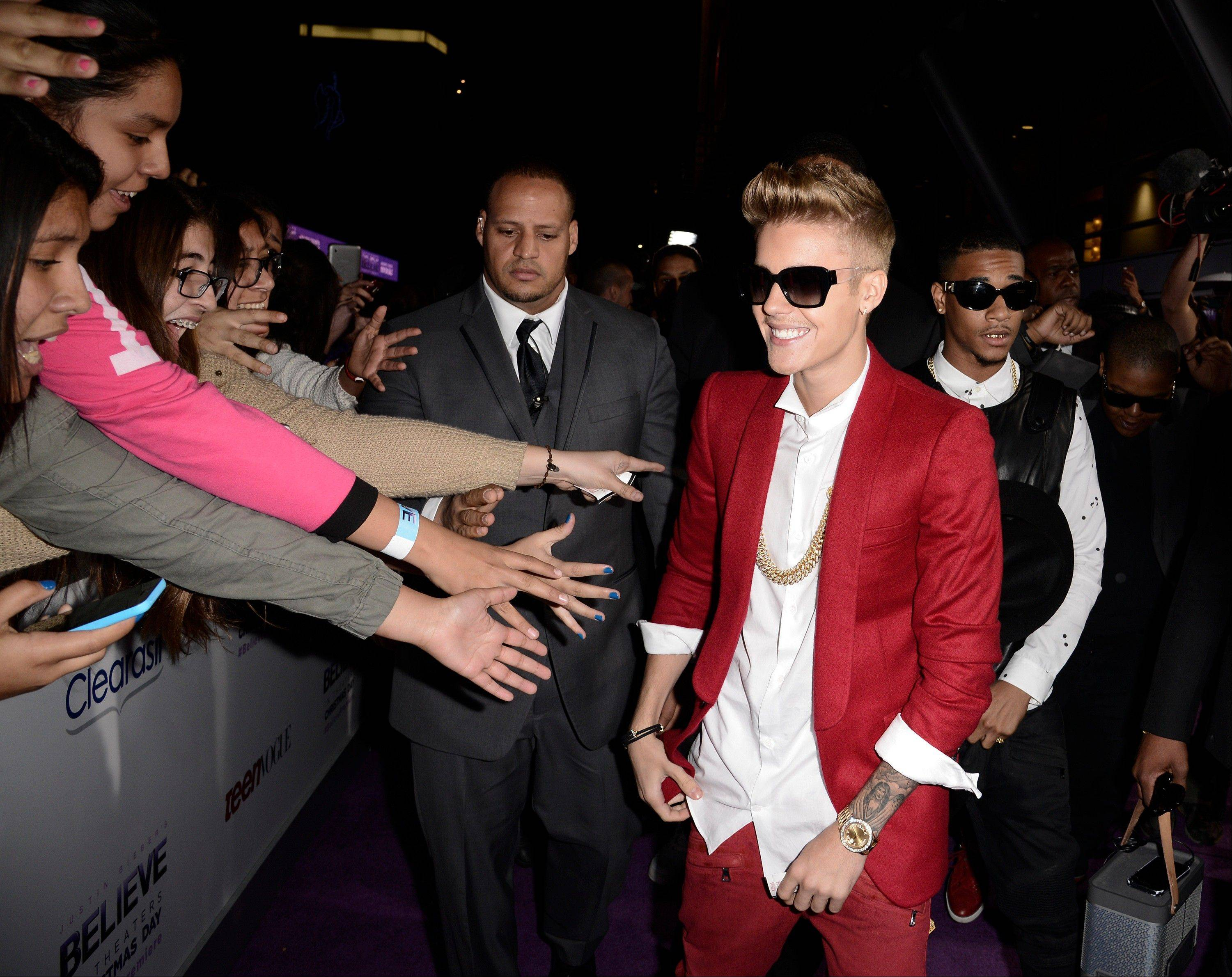"Singer Justin Bieber arrives at the premiere of the feature film ""Justin Bieber's Believe"" at Regal Cinemas L.A. Live on Wednesday, Dec. 18, 2013, in Los Angeles."