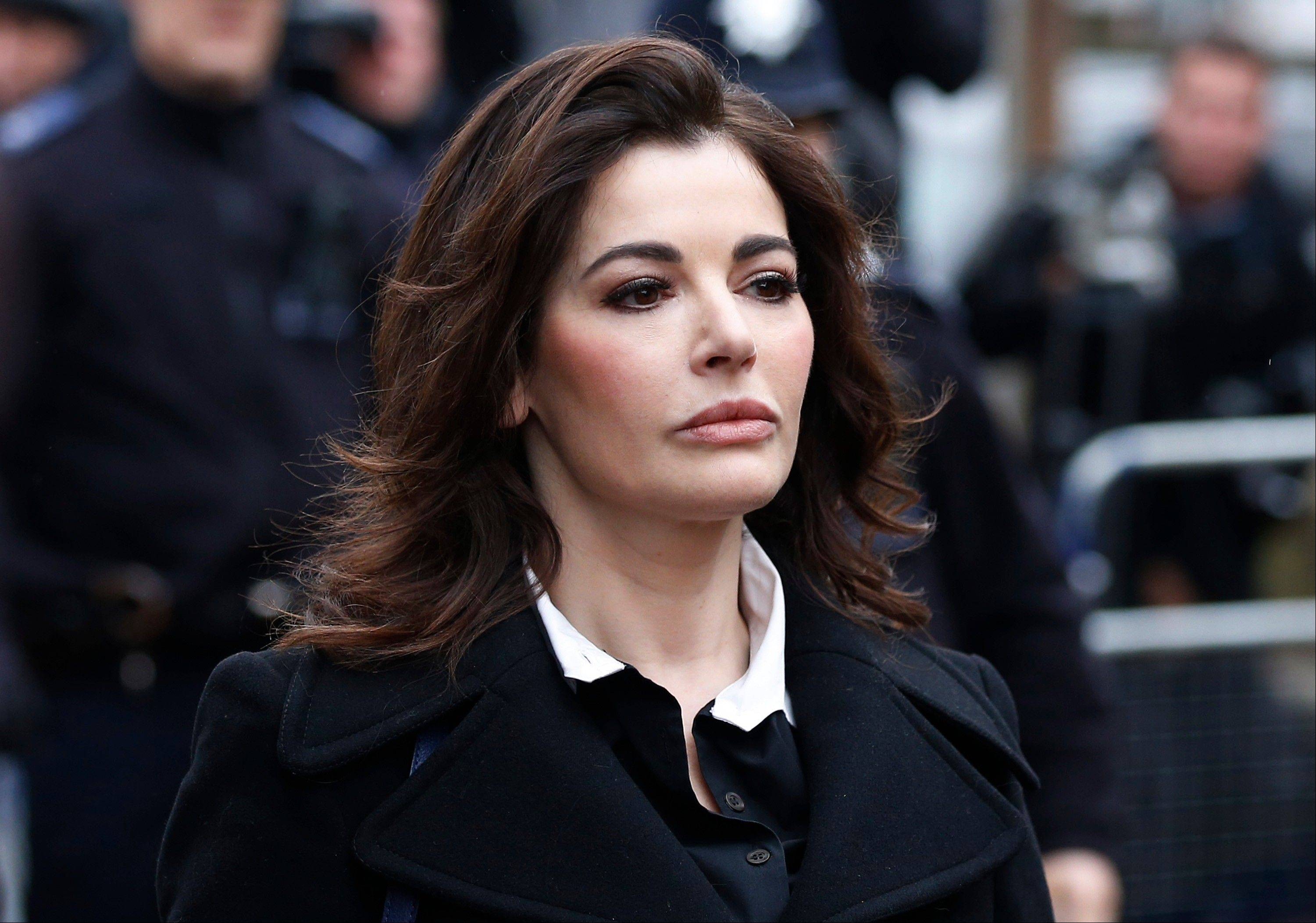 Two former assistants to Nigella Lawson and her former husband were acquitted of fraud Friday, Dec. 20, 2013 in London, capping a case where allegations of unauthorized spending on lavish goods were often overshadowed by titillating glimpses into the celebrity chef's troubled home life.