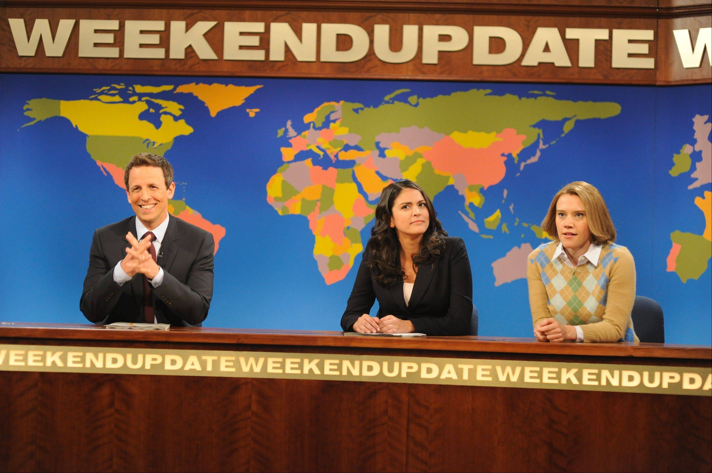"Kate McKinnon, right, plays a soccer mom addicted to ""Grand Theft Auto V"" alongside ""Weekend Update"" anchors Seth Meyers and Cecily Strong in an October episode of ""Saturday Night Live."""