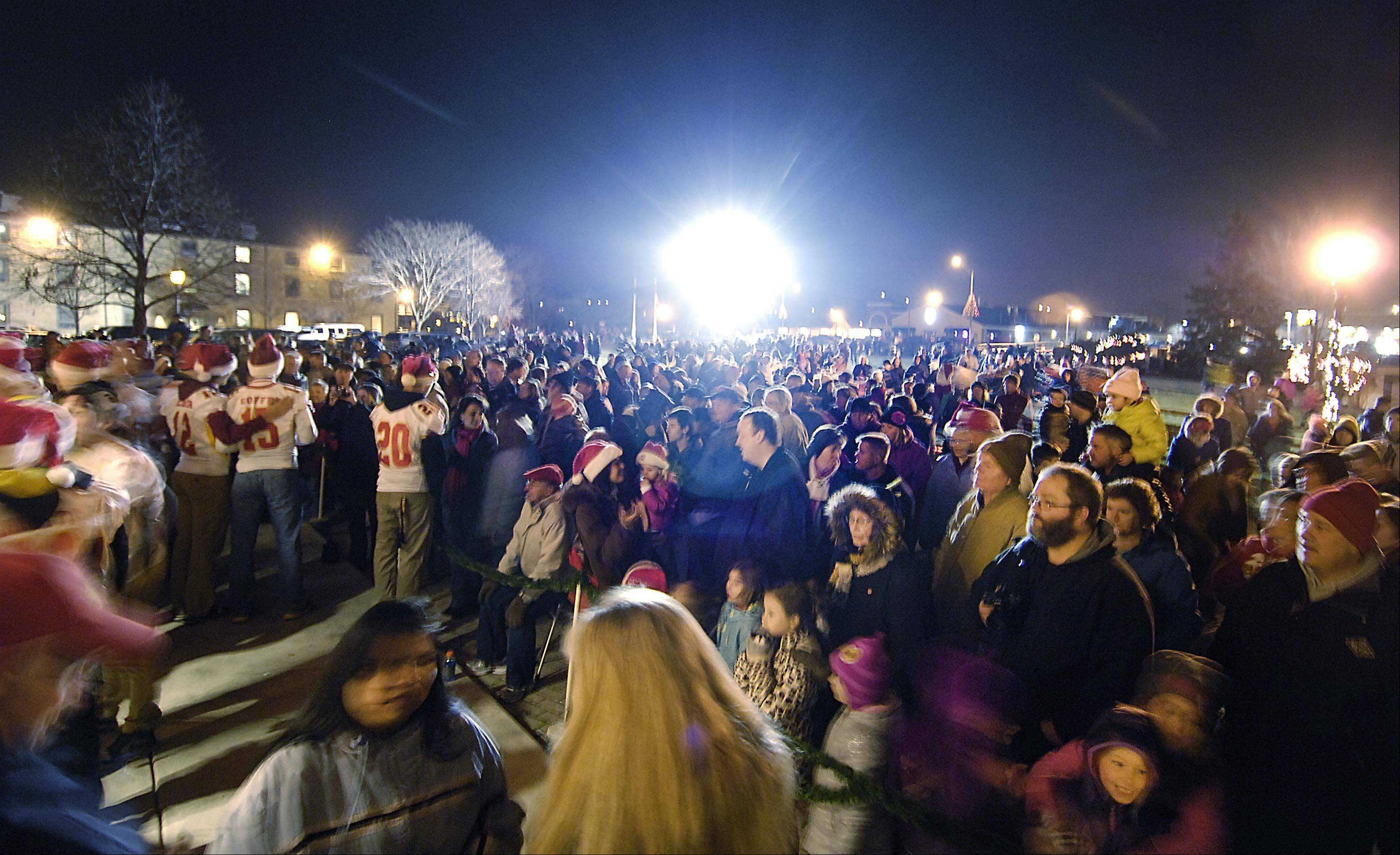 Thousands gather Dec. 1 at the Celebration of Lights Festival on the Batavia Riverwalk to sing holiday songs with the Batavia Community Band. The band will be back on New Year's Eve as the city welcomes in the new year at 9 p.m. Tuesday, Dec. 31.