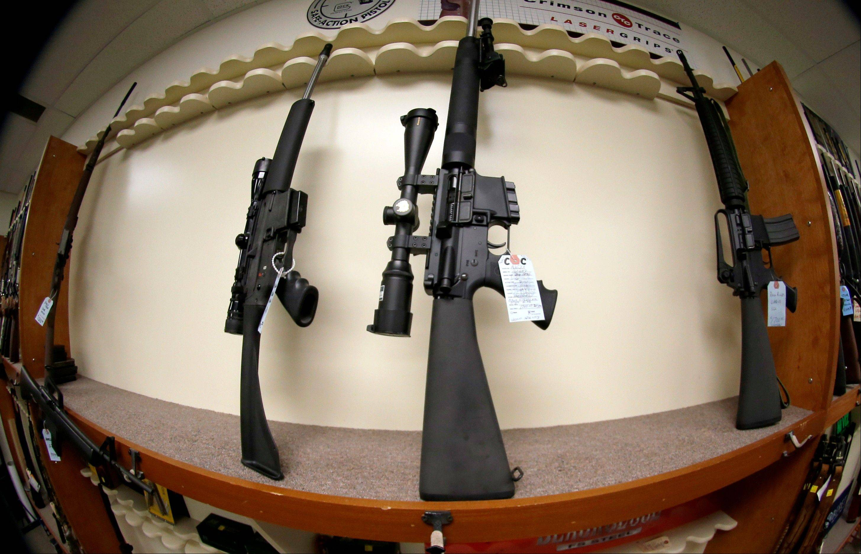 Highland Park has banned assault weapons like these on display at a shop in New Castle, Pa.