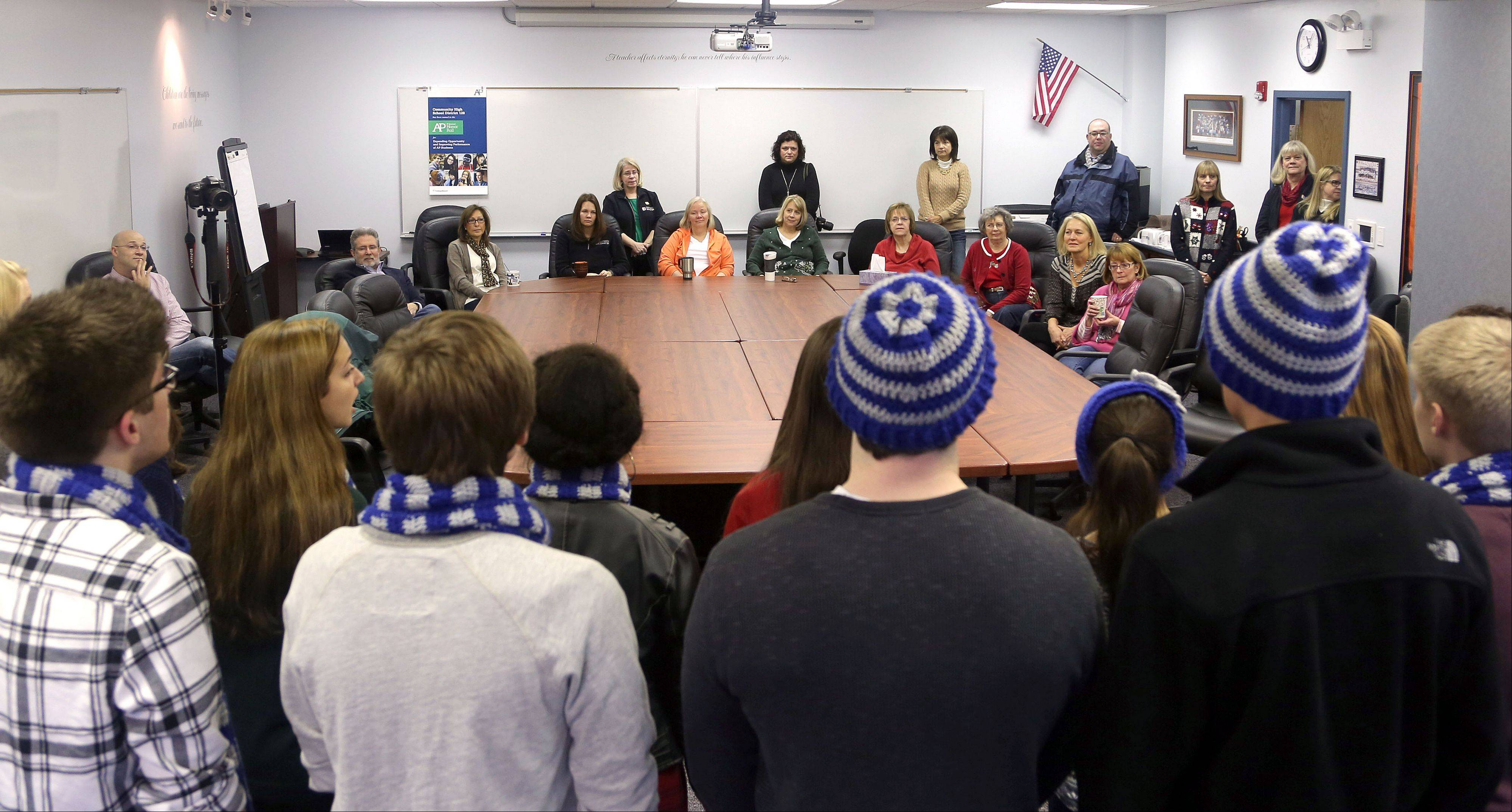 Libertyville-Vernon Hills Area High School District 128 office staff was treated to Christmas carols sung by the Vernon Hills High School chamber choir Friday.