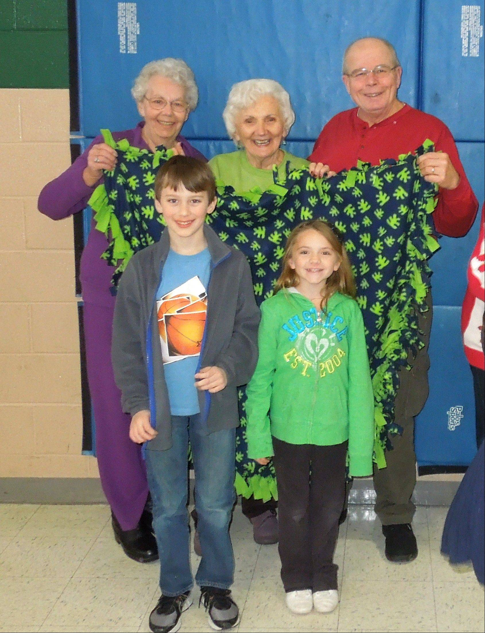 Lois Venn, from left, Sherron Schiewe, and Paul Kozlowski of Lombard were guests at Trinity Lutheran School's Senior Luncheon, where they worked to make blankets for hospice patients with students, including third-grader Andrew Fink of Lombard and fourth-grader Taylor Majer of South Elgin.