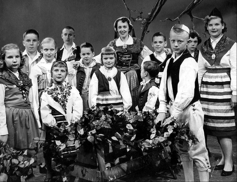 Daily Herald columnist Sammi King, at center in front of Birgit Ridderstedt, appeared with other local children in 1957 on a WTTW special on Swedish Christmas customs.