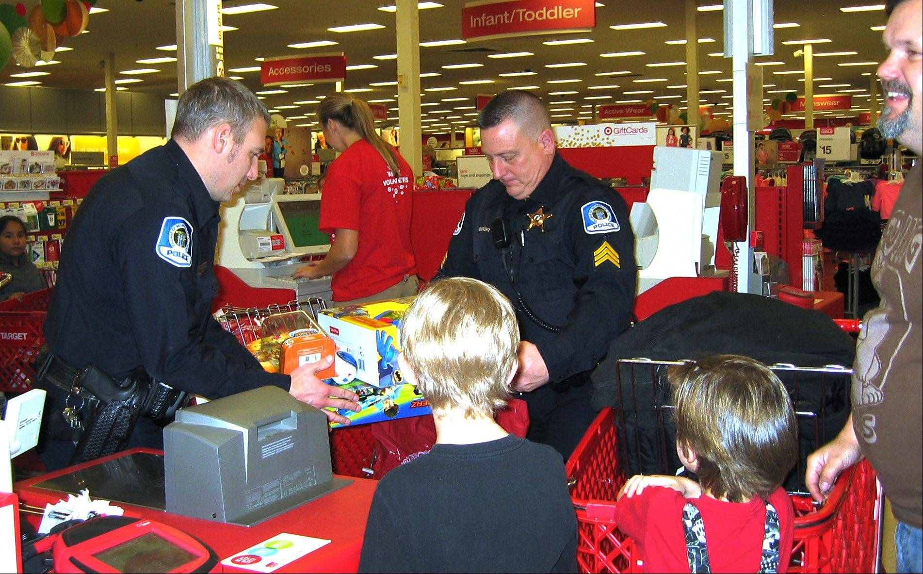 Officer Tony Glogovsky, left, and Sgt. Dan Gorski volunteered to participate in the village of Mundelein´s annual Shop With A Cop program. Thanks to the generosity of village businesses and residents, a record number of children were able to participate in this holiday tradition.
