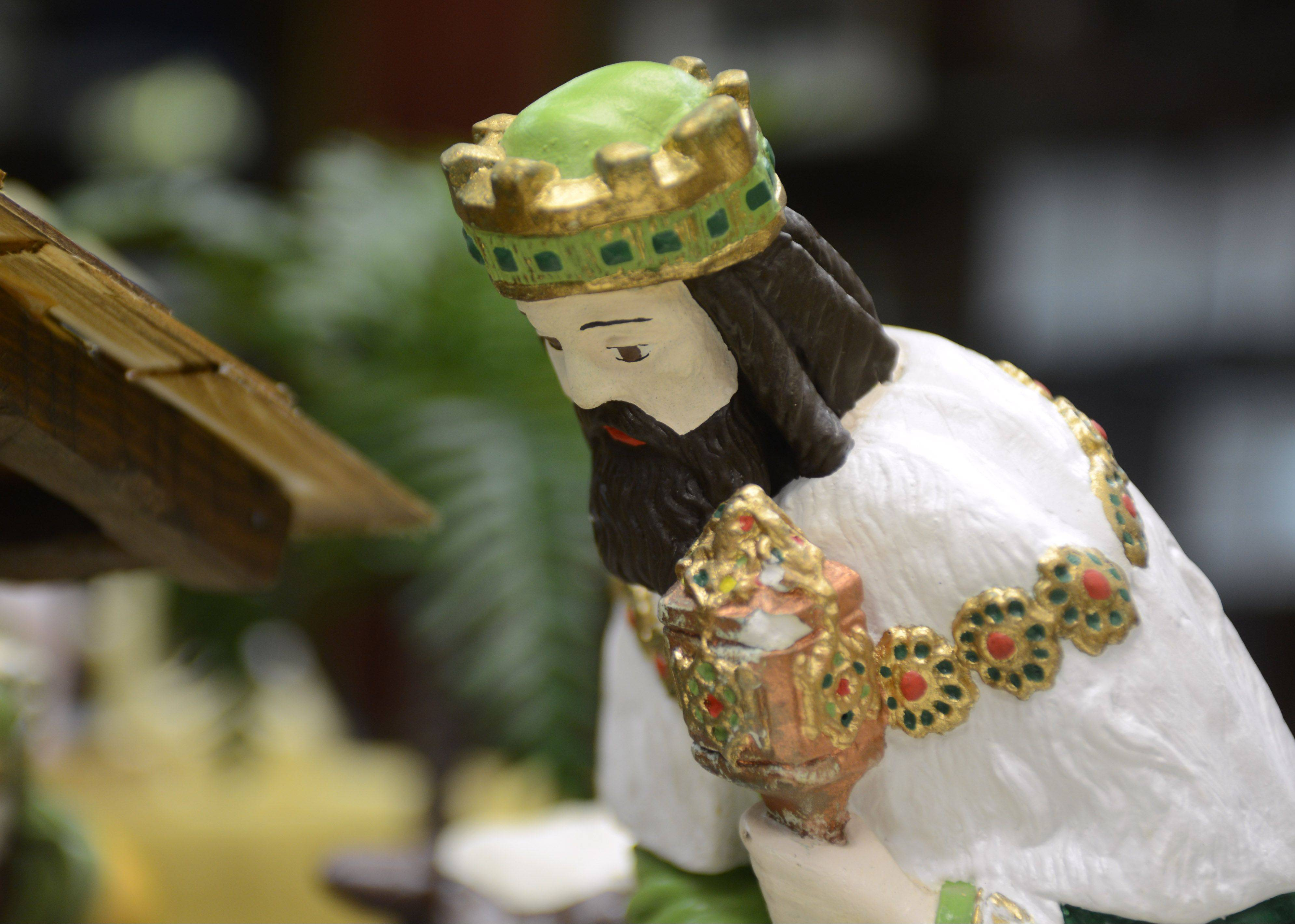 The various Nativity sets on display are made from glass, plastic, paper and wood.