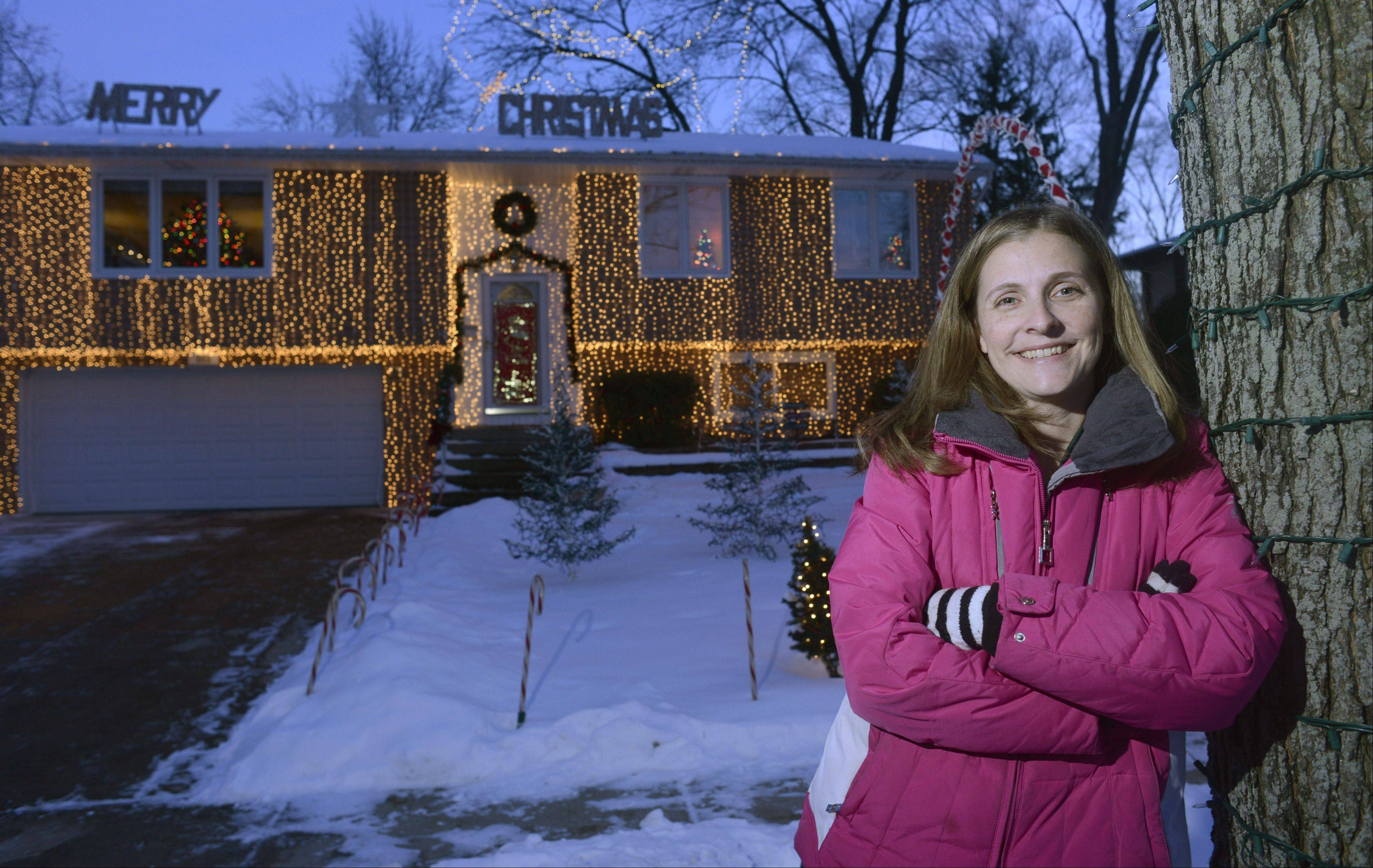 Heather Schluckbier of 503 Dartmouth Lane in Schaumburg is the winner of the Daily Herald Holiday Lights contest. She said winning a contest like this takes a lot of love for the holiday season, and a little bit of craziness.