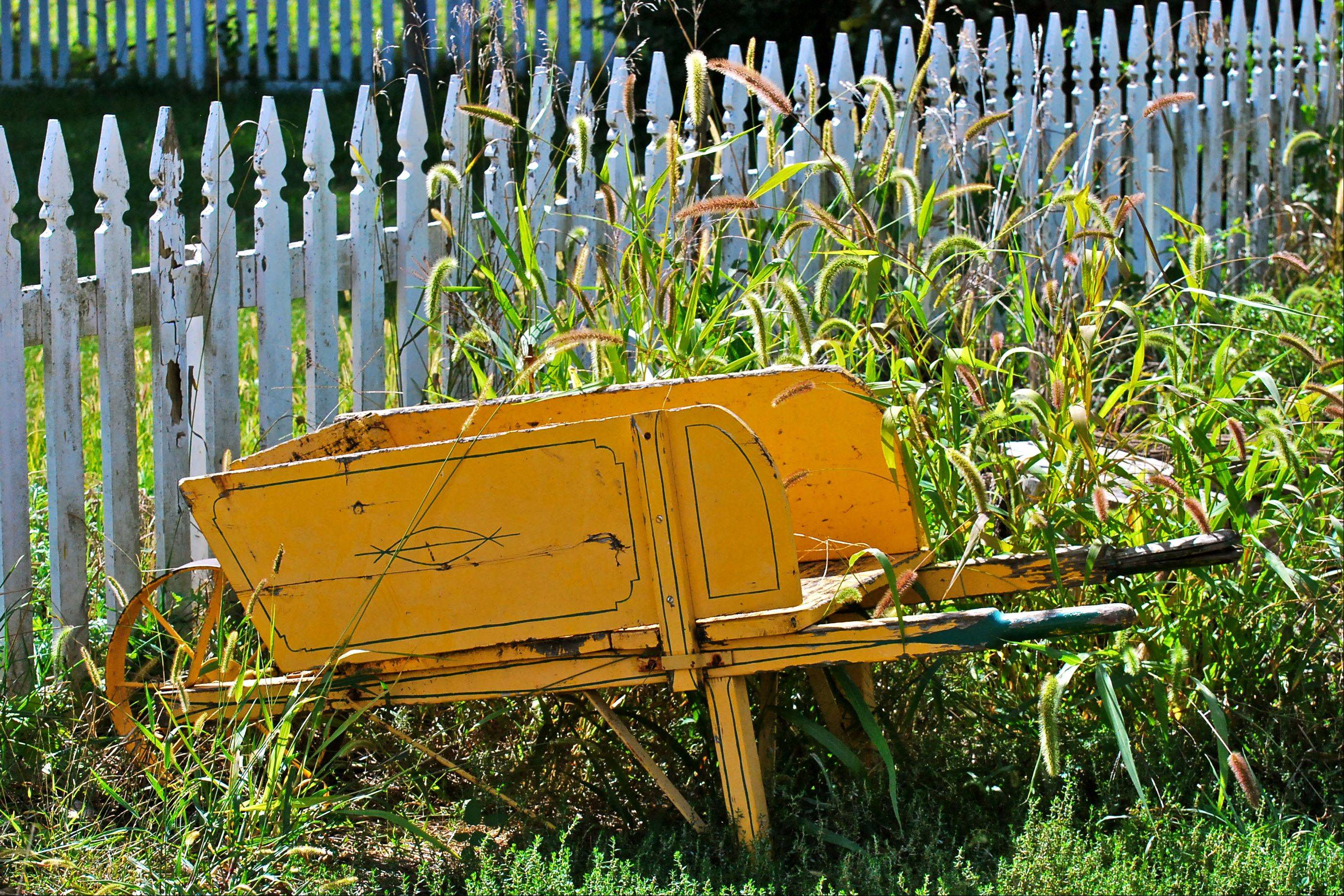 I took this photo at the Living History Farms near Des Moines, Iowa. The fence and wheelbarrow both have seen better days, but together they made an interesting picture.