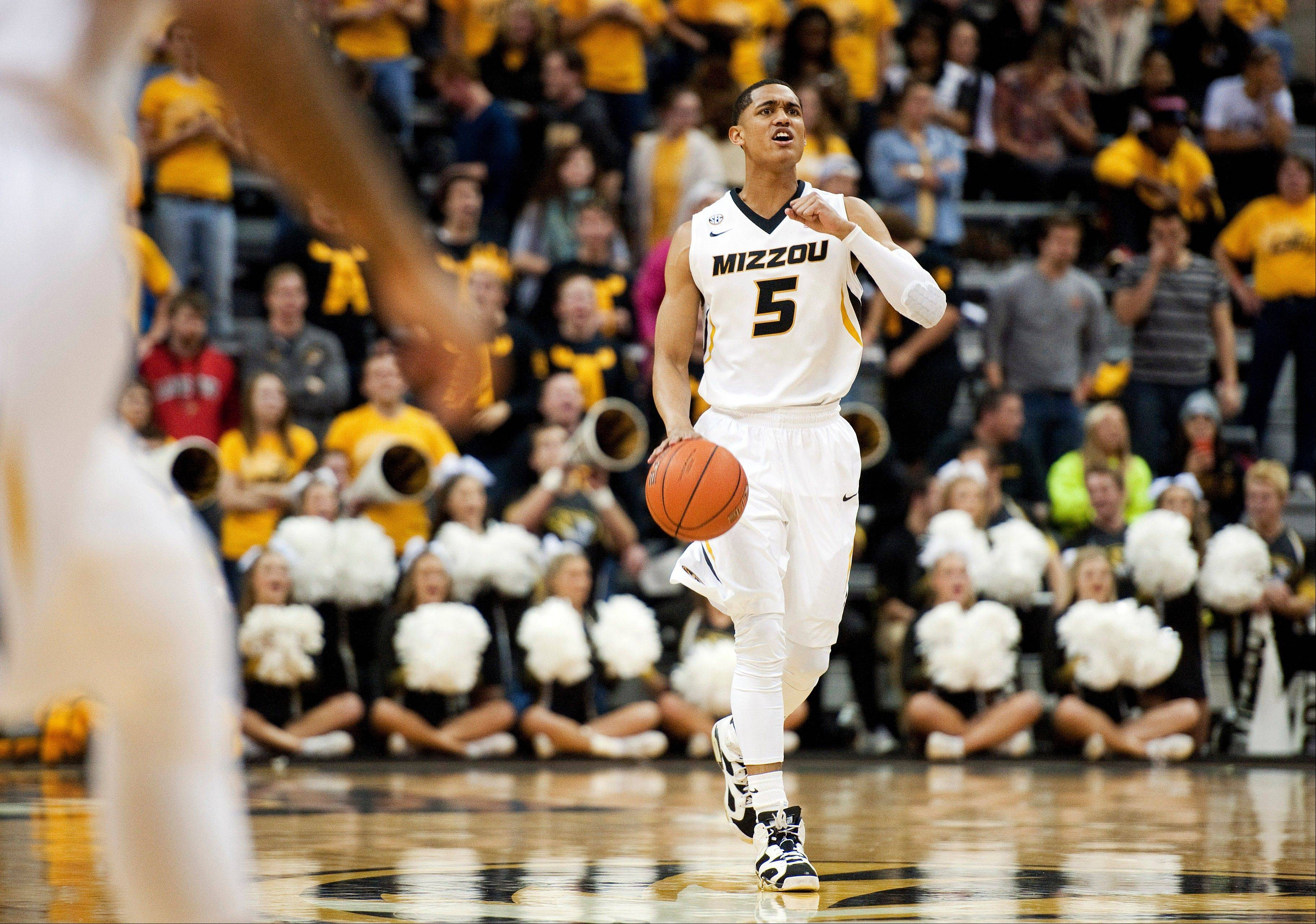 Missouri's Jordan Clarkson brings the ball up court during the first half of an NCAA college basketball game against Western Michigan, Sunday, Dec. 15, 2013, in Columbia, Mo. Missouri won 66-60.