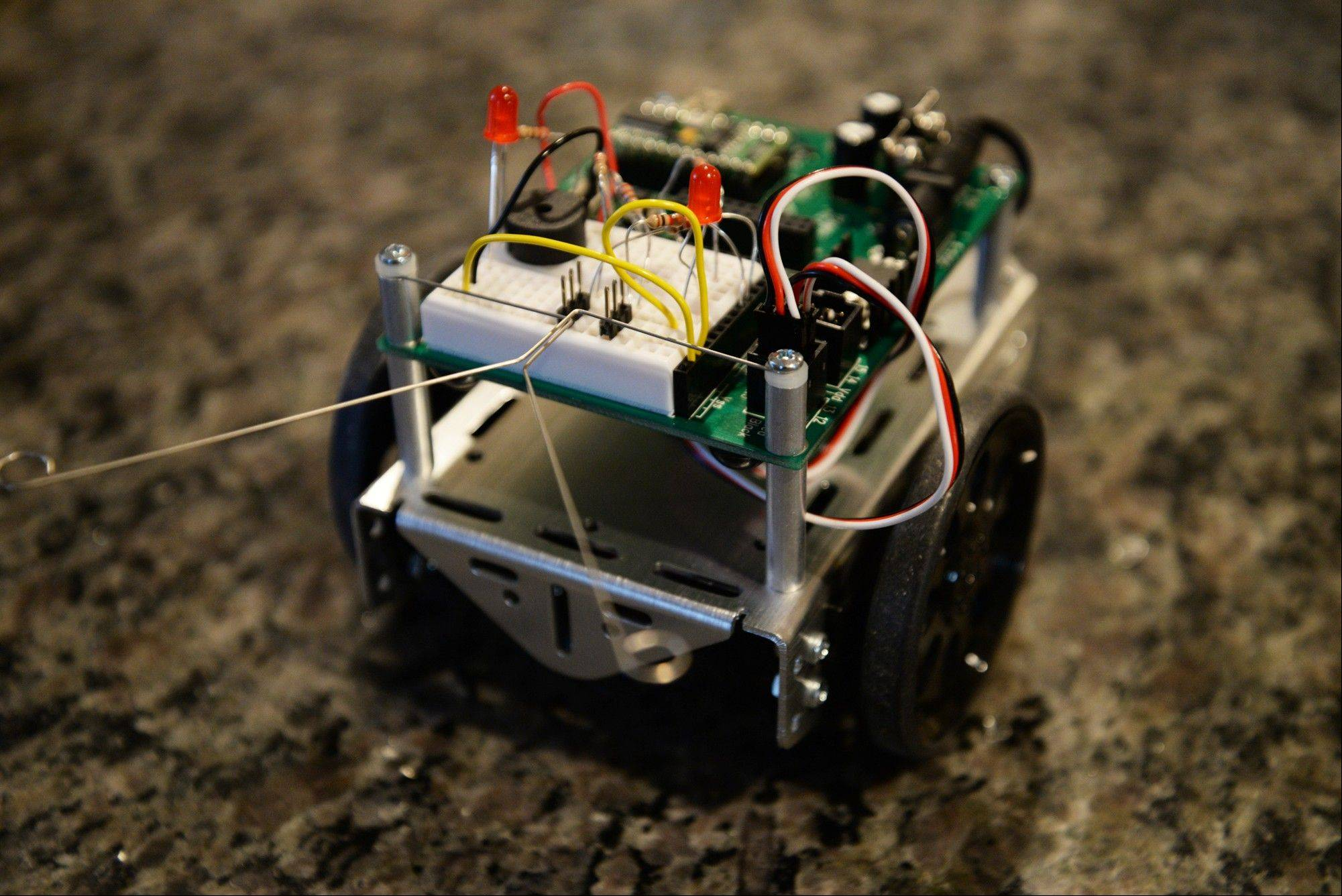The Parallax Boe-Bot programmable robot must be built from scratch and uses tactile feelers and infrared technology to sense object in its path.