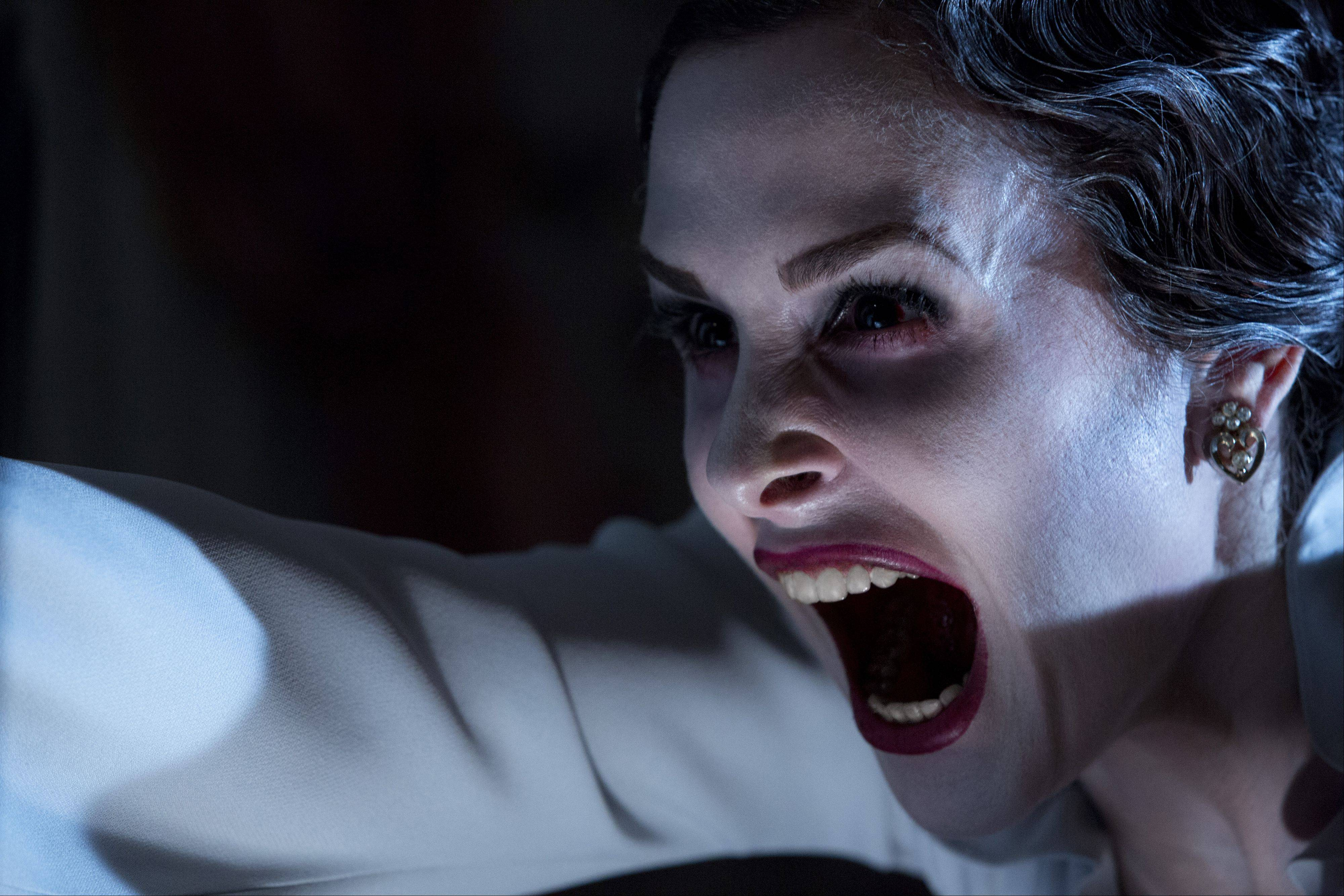An evil ghost (Danielle Bisutti) lets her feelings be known in the sequel �Insidious: Chapter 2.�