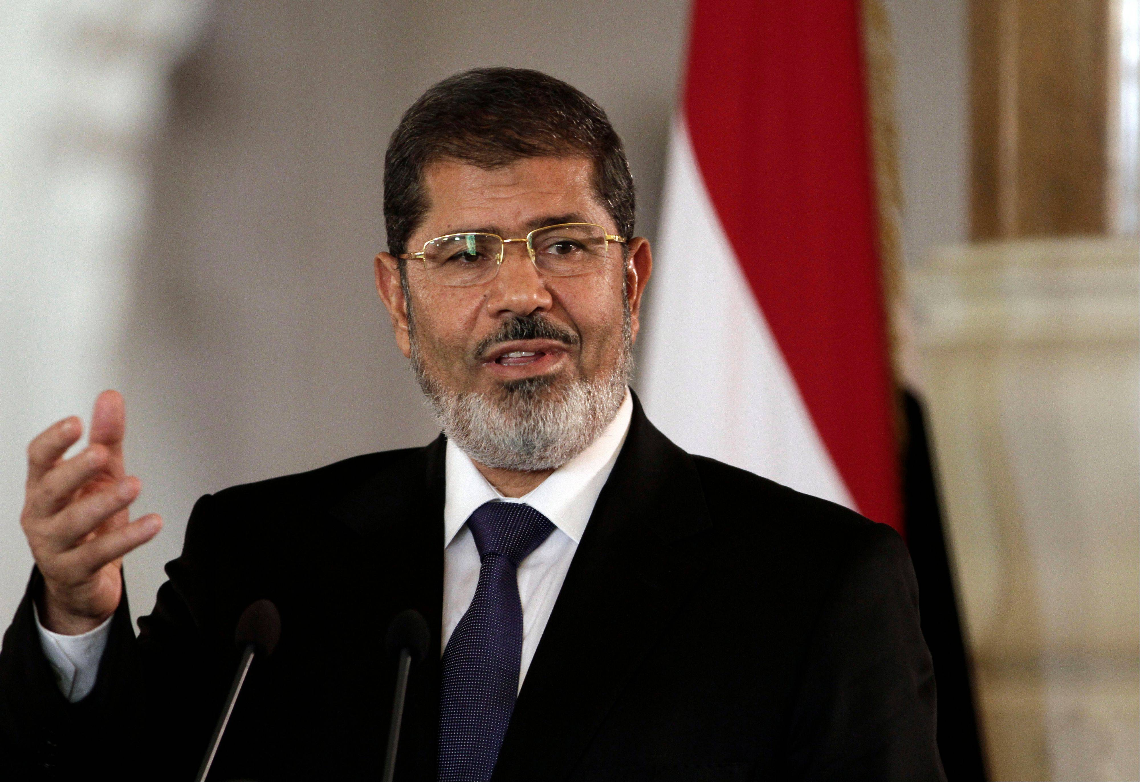 Egyptian President Mohammed Morsi speaks to reporters at the presidential palace in Cairo.