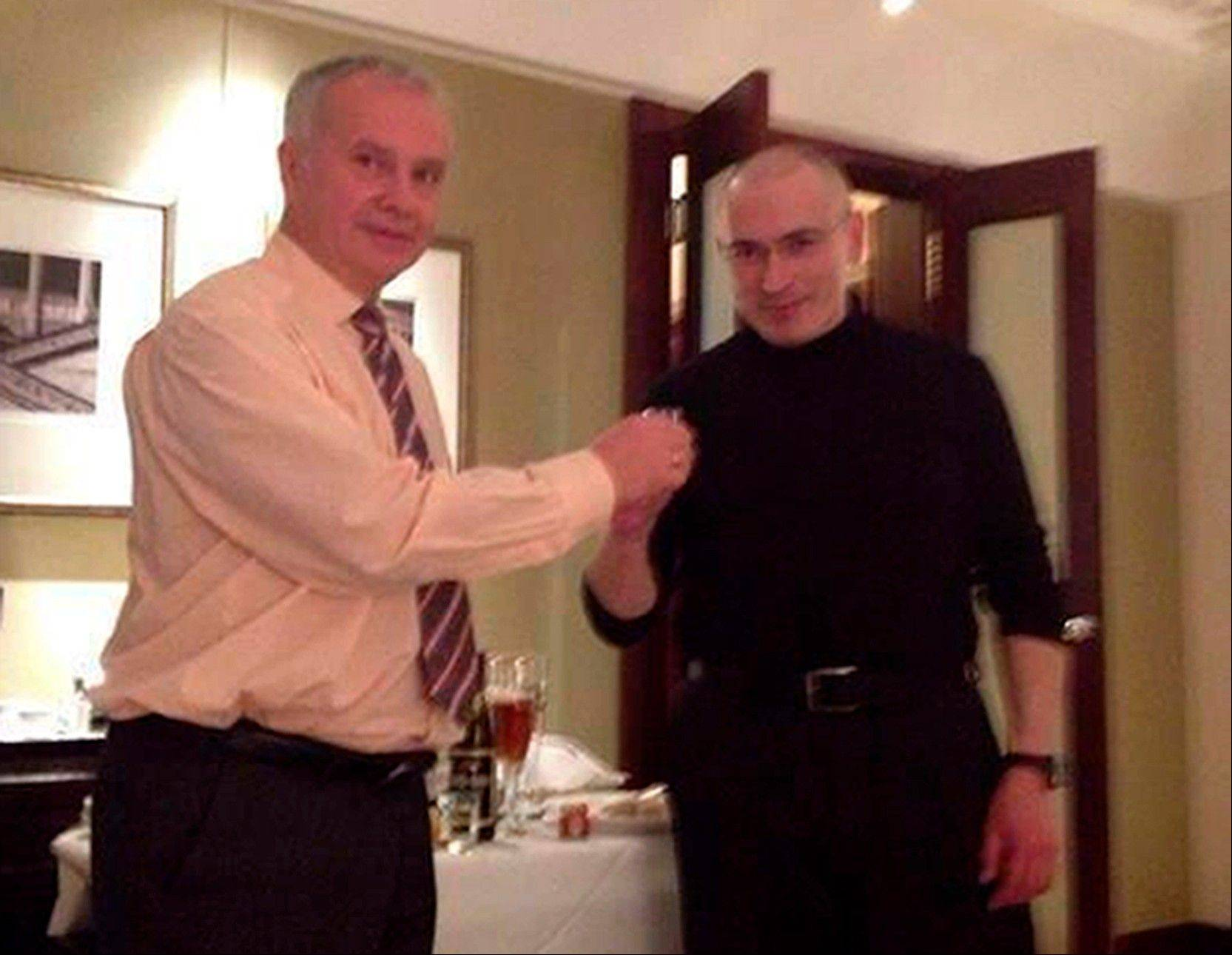 Russian oligarch Mikhail Khodorkovsky, right, toasts with political scientist Alexander Rahr in the hotel �Adlon� in Berlin, Germany.