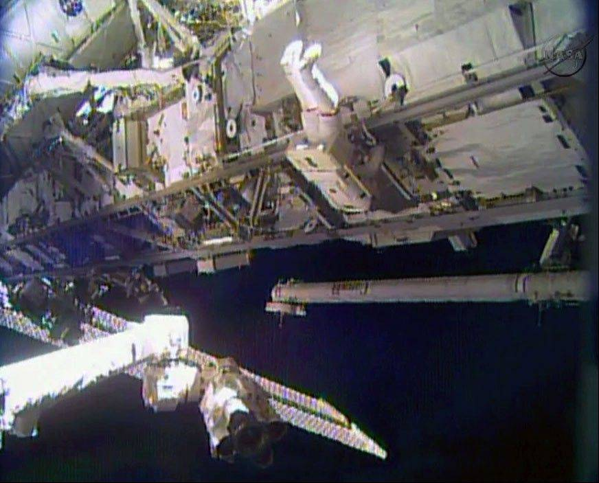 In this image made from video provided by NASA, astronaut Rick Mastracchio performs a spacewalk outside the International Space Station on Saturday, Dec. 21. Mastracchio and Michael Hopkins ventured out of the station to try to revive a crippled cooling line.