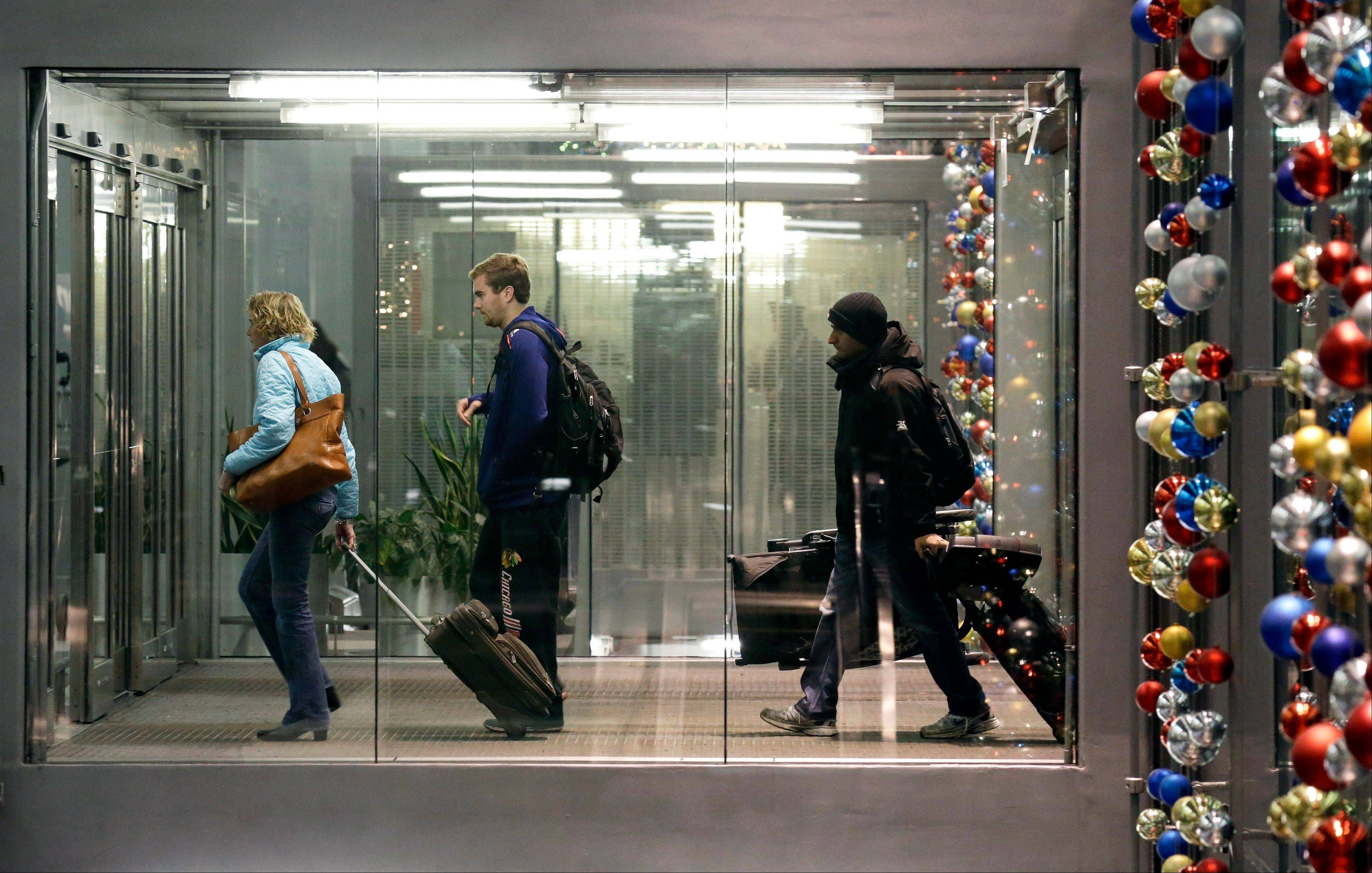 Associated Press Passengers walk through Terminal 3 at O'Hare International Airport in Chicago on Saturday, Dec. 21. The National Weather Service issued a hazardous weather outlook for north central Illinois, northeast Illinois and northwest Indiana on Saturday morning.