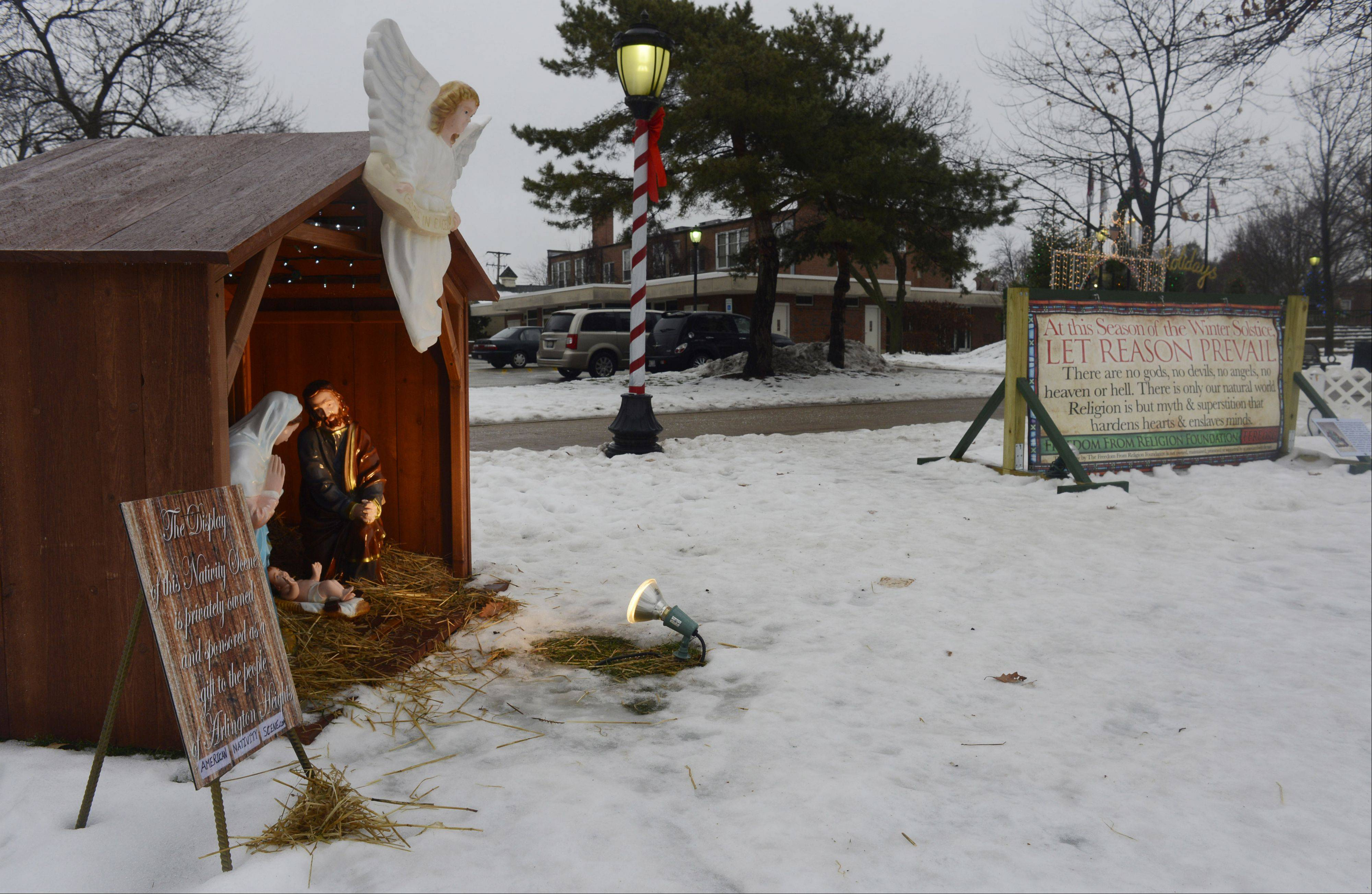 Last year, the Illinois Nativity Scene Committee pushed for permission to place a Nativity scene in North School Park in Arlington Heights. The Freedom From Religion Foundation responded with a sign opposing religion, at right. Both are back this year.