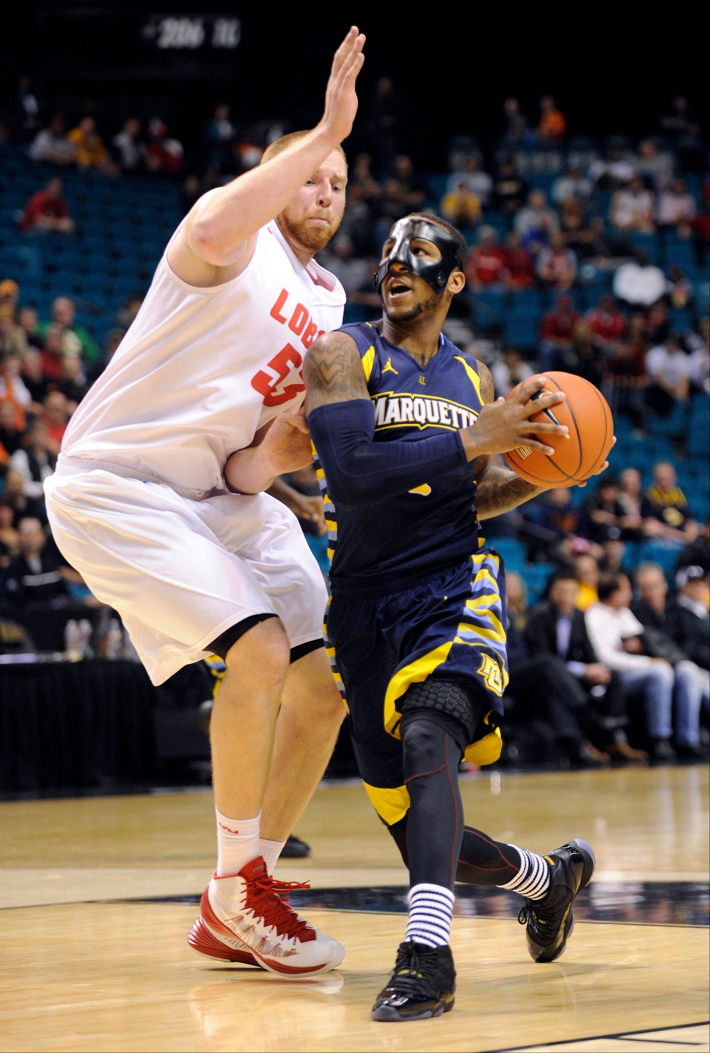 Marquette�s Todd Mayo drives to the basket against New Mexico�s Alex Kirk during the second half of their game Saturday in Las Vegas.