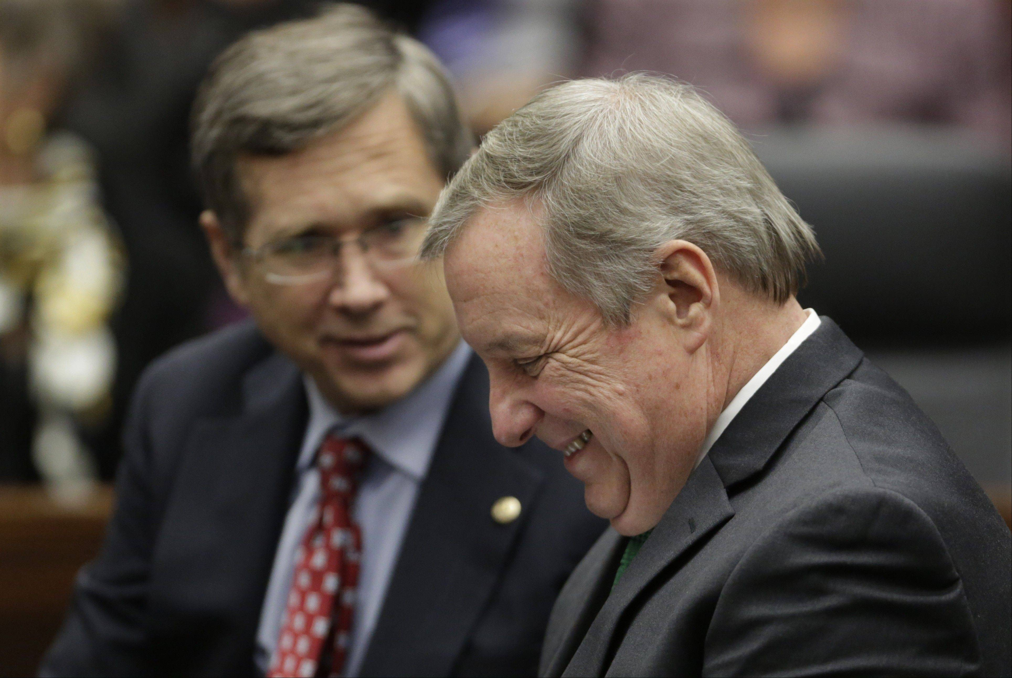 "In this Nov. 25, 2013 photo, U.S. Sens. Dick Durbin, an Illinois Democrat, left, and Mark Kirk, an Illinois Republican, laughing together before Zachary T. Fardon, takes a ceremonial oath as United States attorney for the Northern District of Illinois in Chicago. On Capitol Hill, where the partisan divide runs so deep it shut down the government, it can be unusual for members of opposing parties to have close relationships. Both men say they've always had an amicable relationship. But their friendship truly solidified after Kirk suffered a stroke last year and they began a series of what the junior senator calls ""heart-to-hearts"" about how they could do their jobs better by working together."