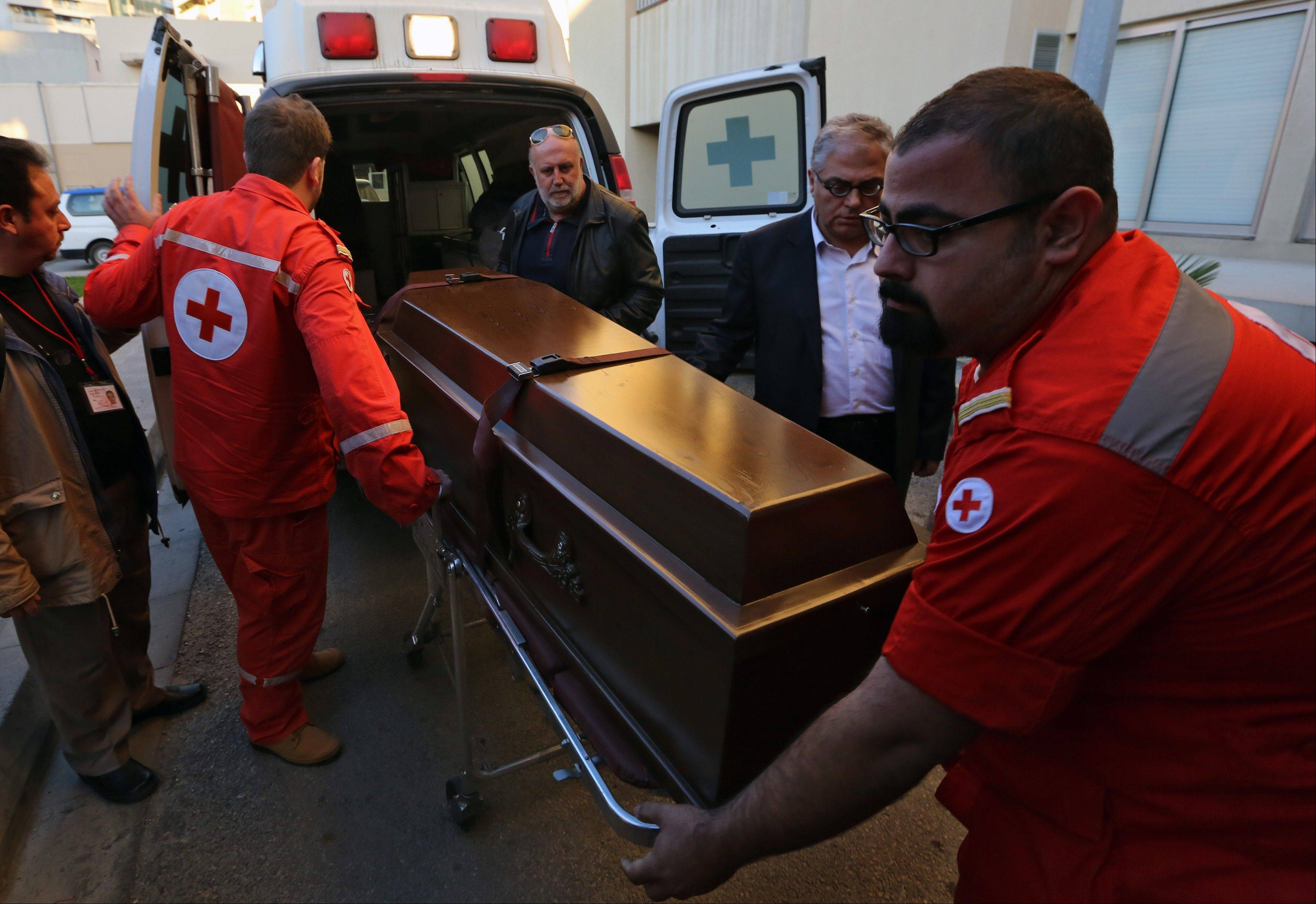 Associated PressLebanese Red Cross workers carry the coffin of British doctor Abbas Khan, 32, who was seized by Syrian government troops in November 2012, into the Hotel-Dieu de France hospital in Beirut, Lebanon, Saturday, Dec. 21. The circumstances in which Khan died while in detention in Syria remain in dispute. A senior British official has accused Syrian President Bashar Assad's government of effectively murdering Khan, while the Syrian authorities say the doctor committed suicide and there was no sign of violence or abuse.