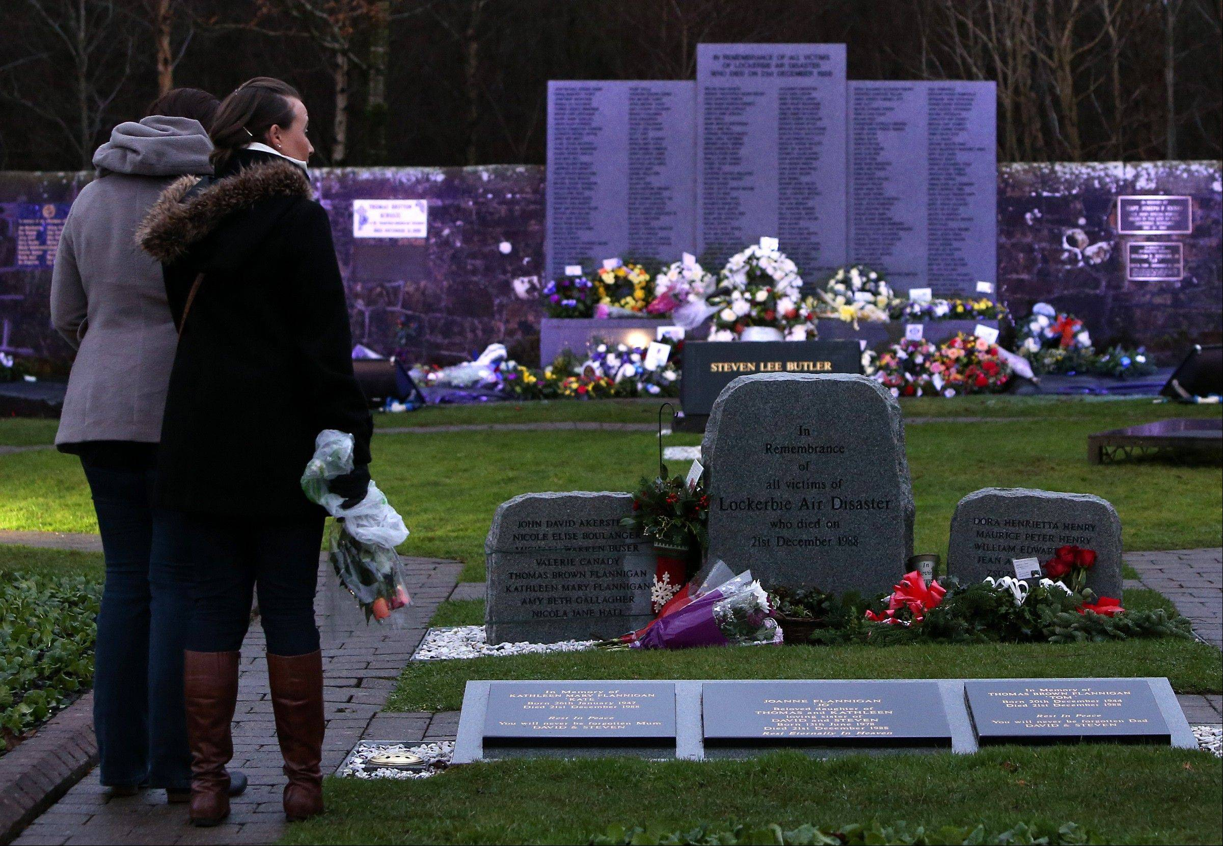 Associated PressMembers of the public view the scene at the main memorial stone in memory of the Lockerbie victims of Pan Am flight 103 bombing in the garden of remembrance at Dryfesdale Cemetery, near Lockerbie, Scotland, Saturday Dec. 21. Pan Am flight 103 was blown apart above the Scottish border town of Lockerbie on Dec. 21, 1988. All 269 passengers and crew, on the Pan Am flight and 11 people on the ground were killed in the bombing.