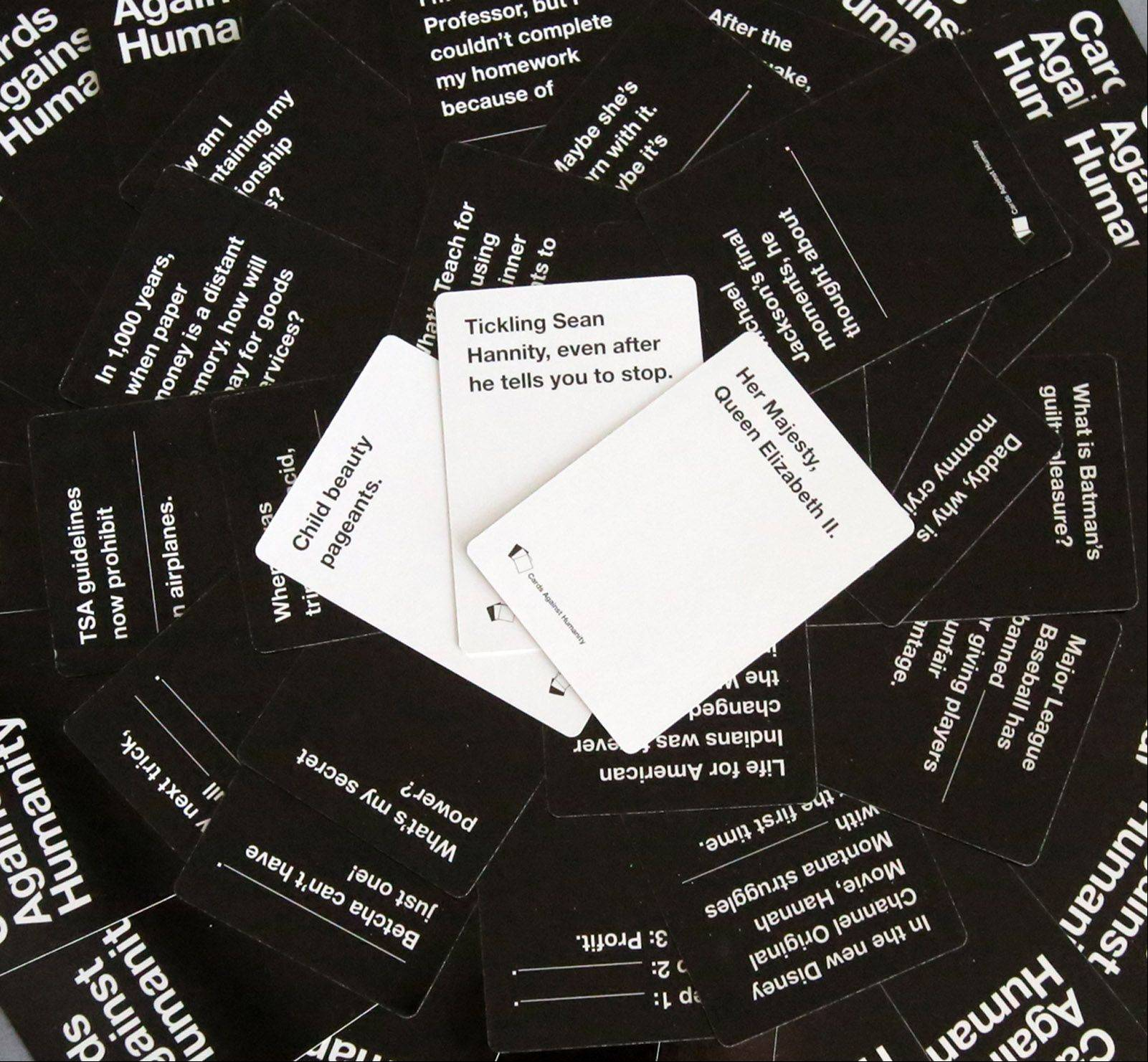 Cards Against Humanity players match their best answer on a white card to a question on a black card.