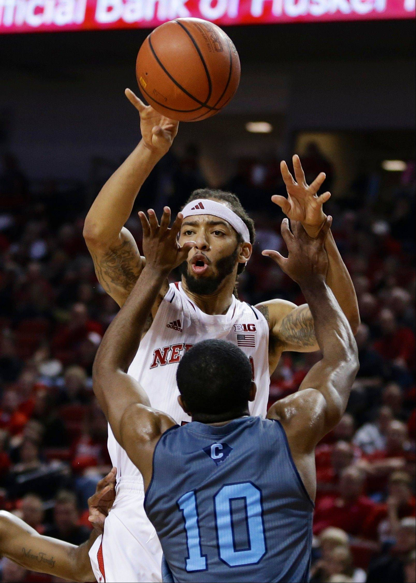 Nebraska's Terran Petteway passes the ball over The Citadel's Marshall Harris III during the second half of Saturday's game in Lincoln, Neb.