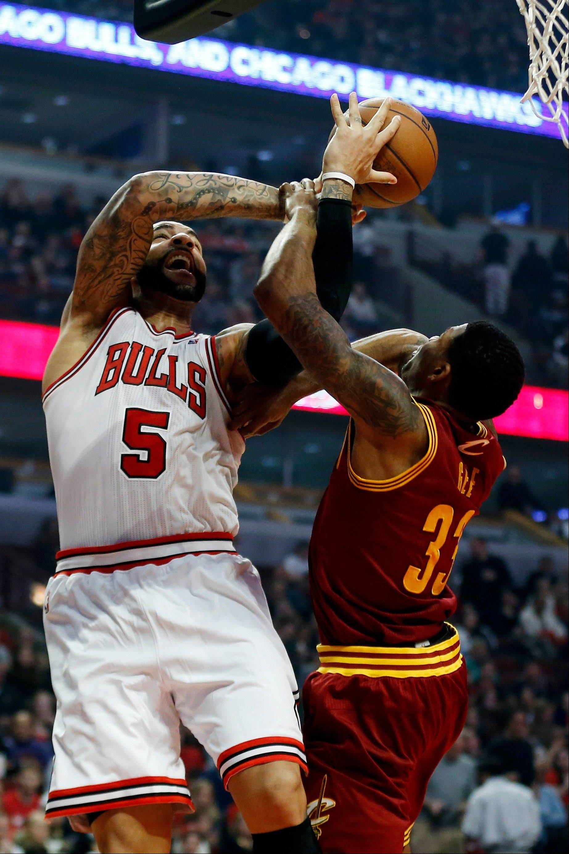 Bulls forward Carlos Boozer draws a foul from Cleveland Cavaliers forward Alonzo Gee during the second half of Saturday's game in Chicago.
