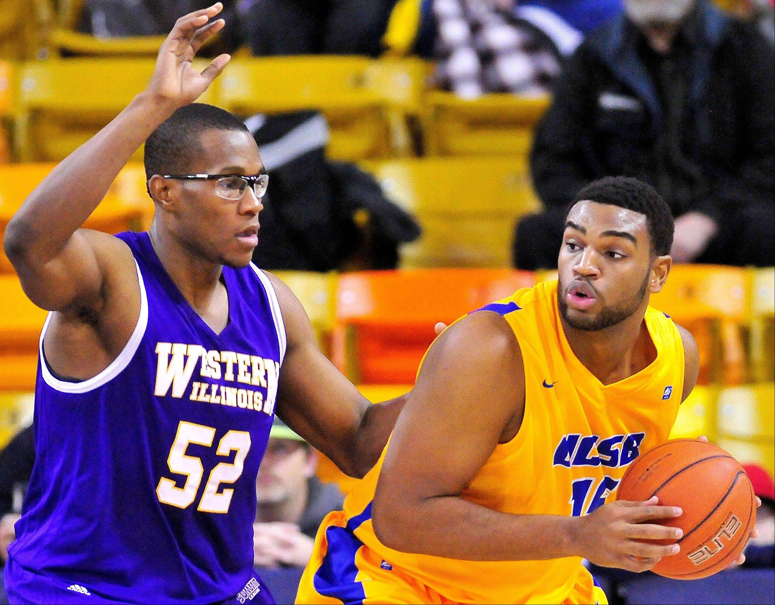 UC Santa Barbara's Alan Williams looks to make a pass while being guarded by Western Illinois' Michael Ochereobia on Saturday in Logan, Utah.