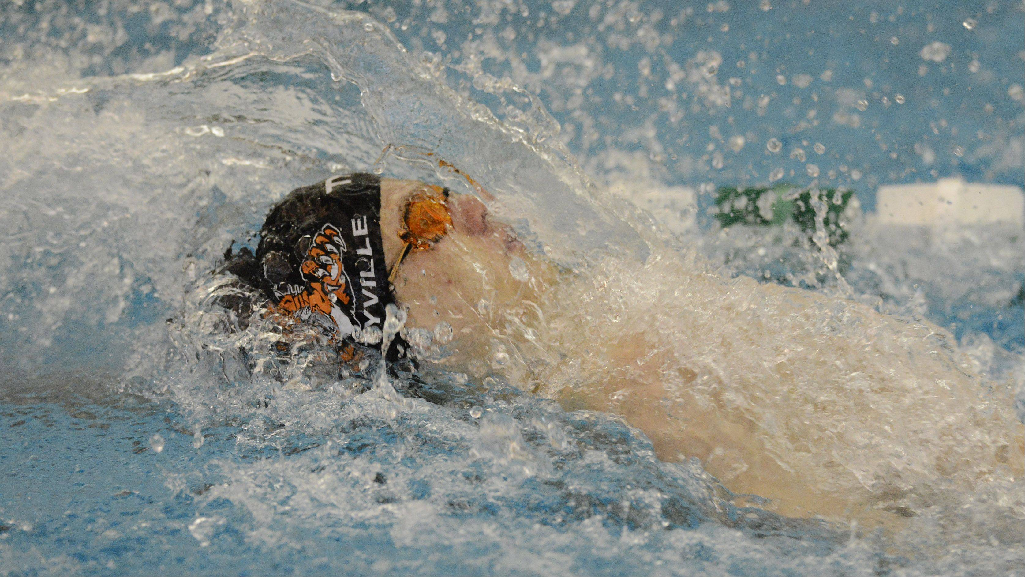 Libertyville's Alex Snarski swims backstroke in the 200-yard medley relay during the Lake County meet at Stevenson High School in Lincolnshire on Saturday.