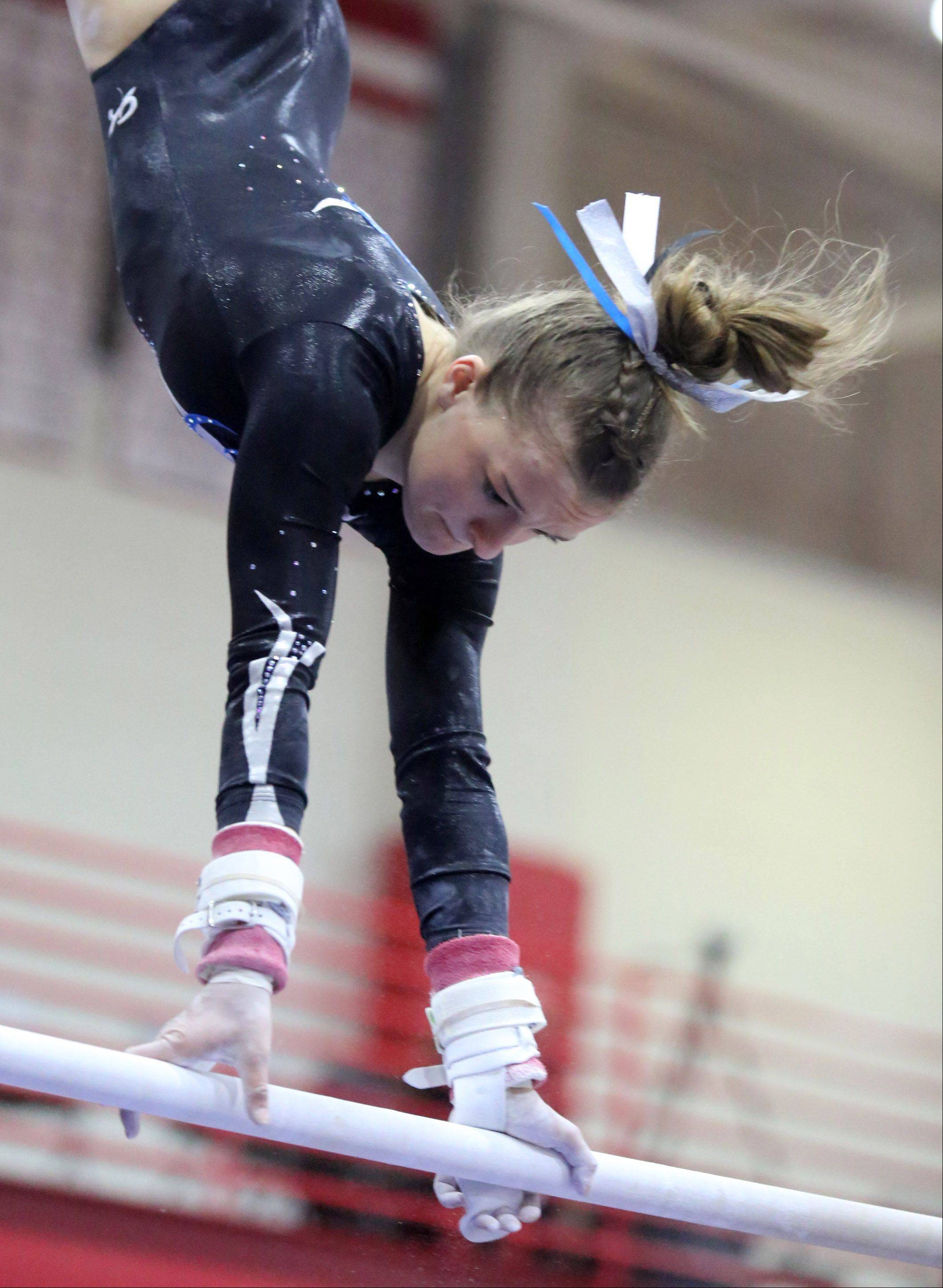 Prospect's Maddie Larock on the uneven parallel bars at the 25th annual Palatine Invitational on Saturday.