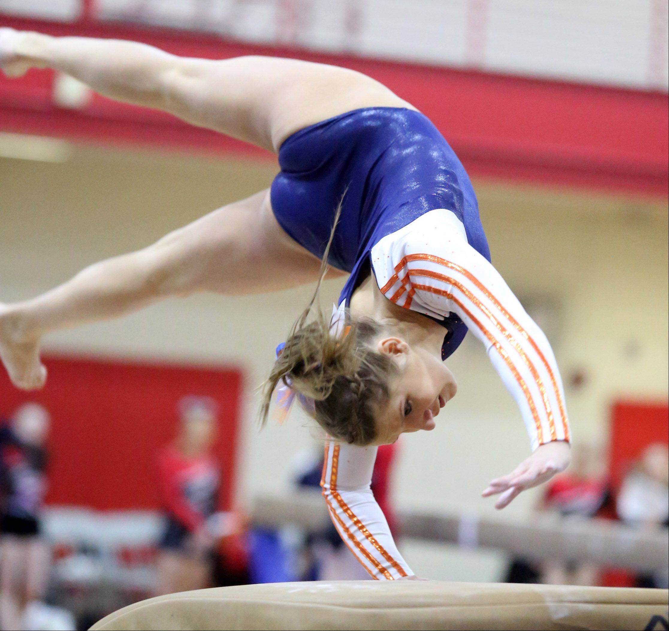 Naperville North's Michaela Robert on the vault at the 25th annual Palatine Invitational on Saturday.