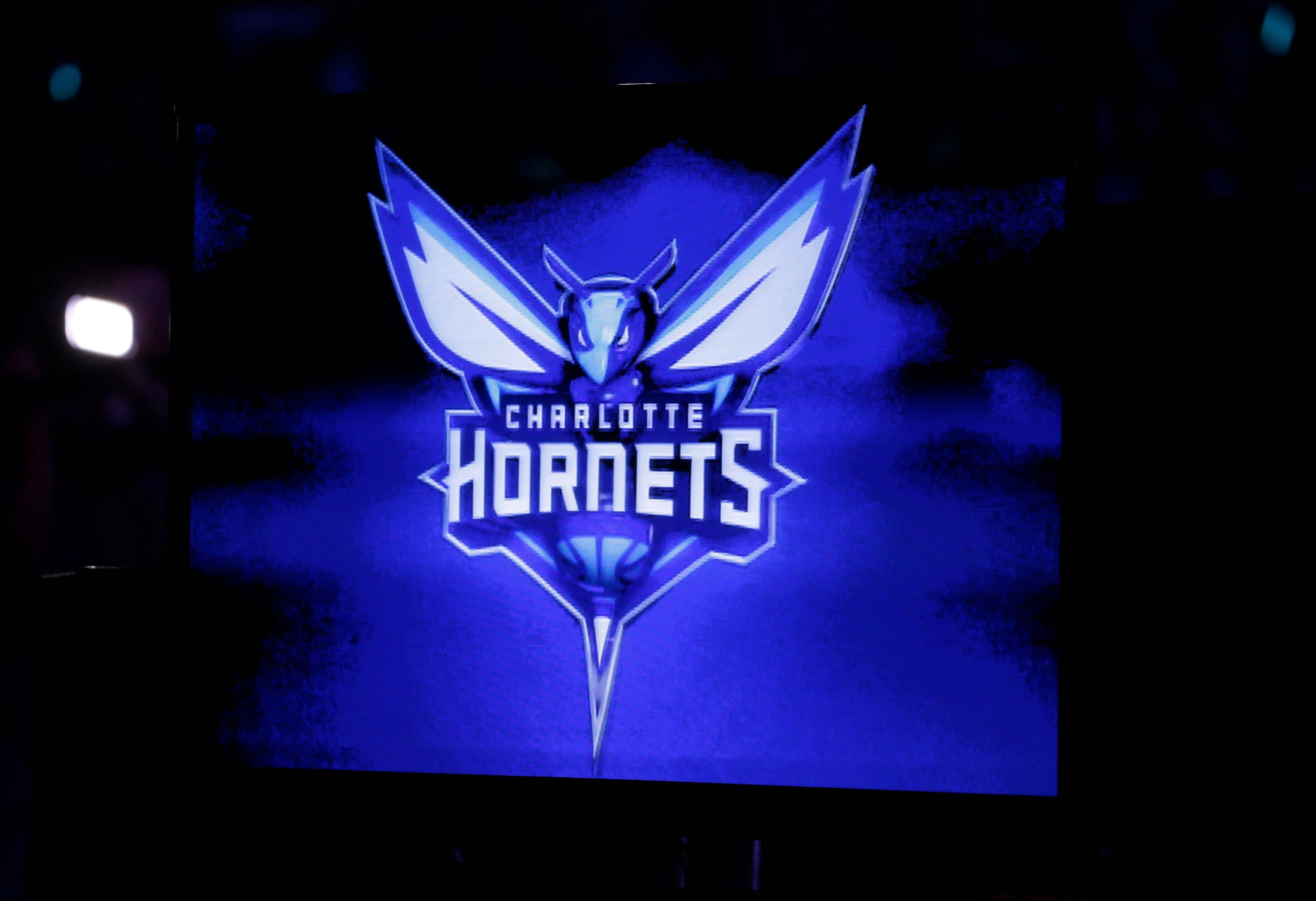 The new logo of the Charlotte Hornets is displayed on a video monitor during halftime of the game between the Charlotte Bobcats and the Utah Jazz on Saturday in Charlotte, N.C. The Bobcats will change their name to the Hornets next season.