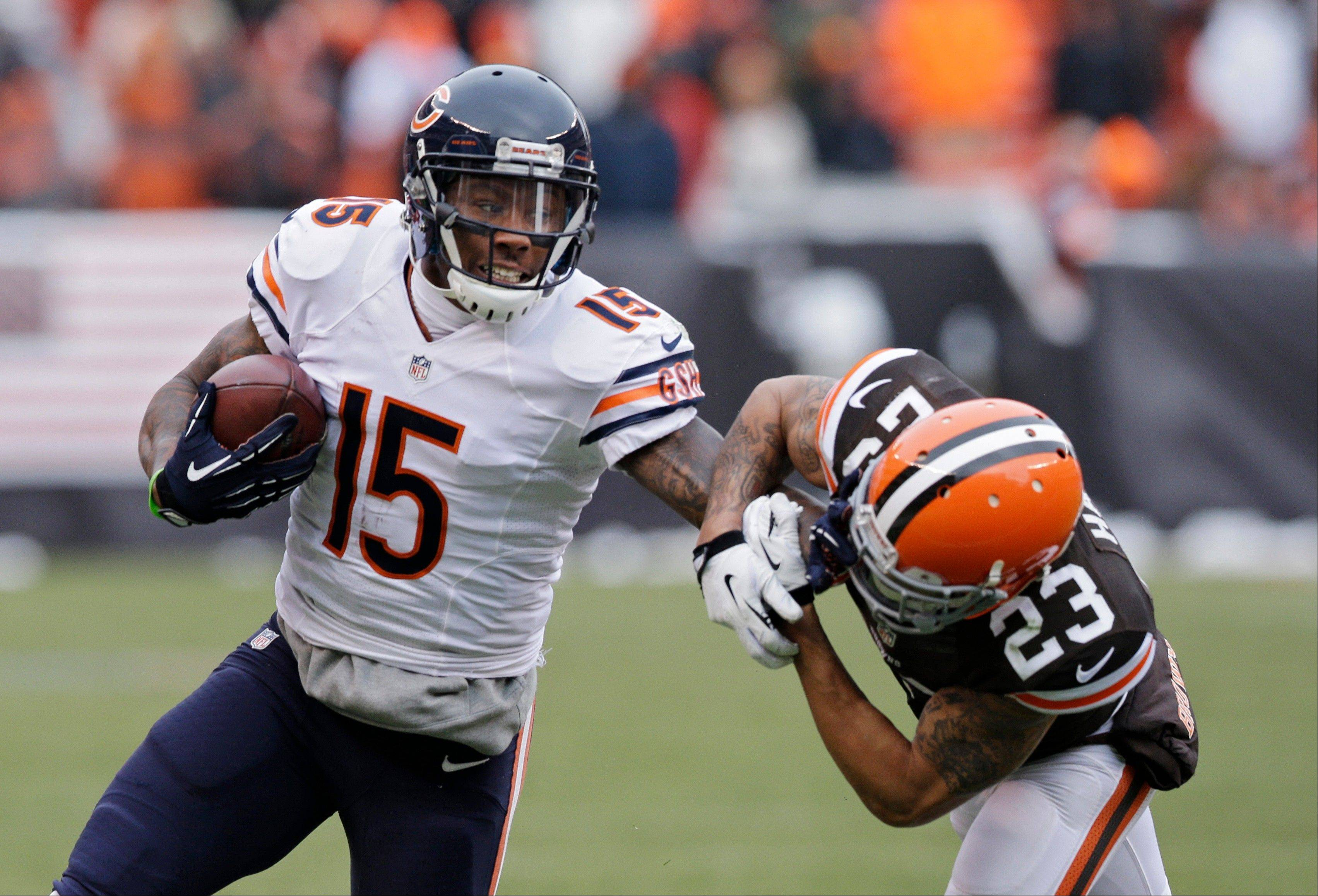 "Brandon Marshall pushes Browns cornerback Joe Haden away after a catch last week. Marshall says he has selfish reasons for being such a good blocker when the Bears are running the ball. ""When the running game is doing good,"" Marshall said, ""it opens up (the passing game)."""