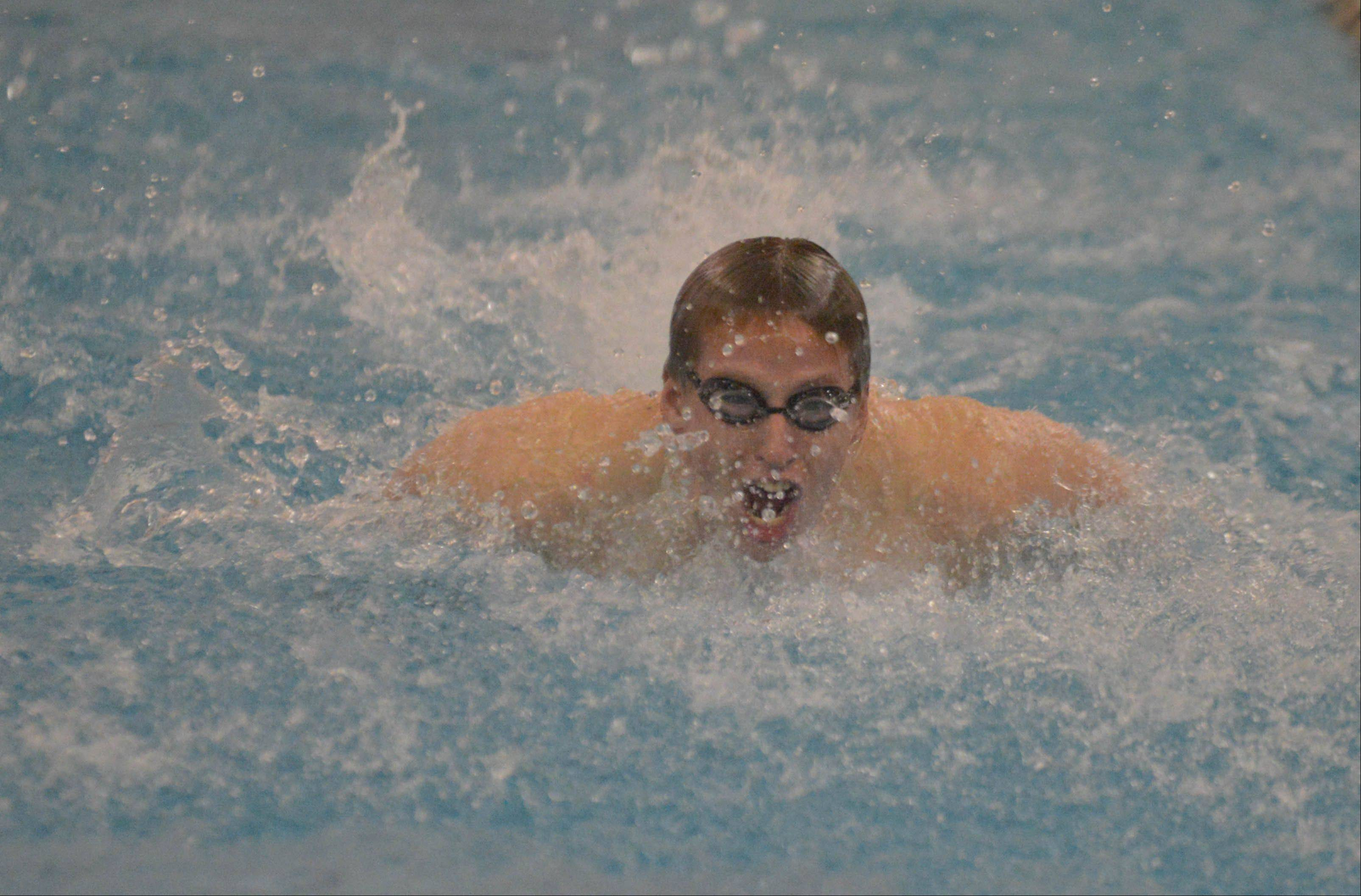 Tim Steele of Saint Charles North during the 200 Yard Medley Relay at the Neuqua Valley boys swimming invitational Saturday.