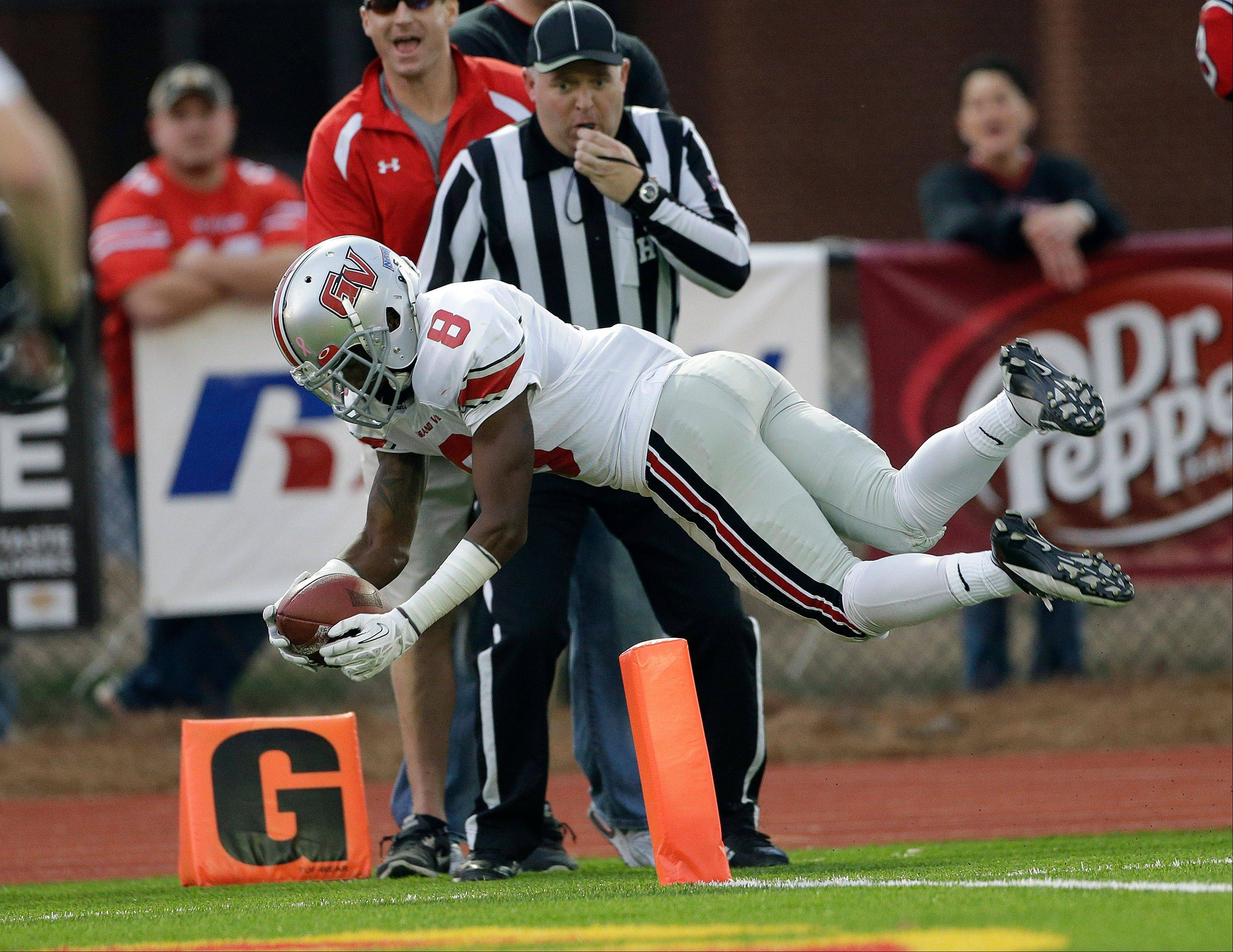 Grand View receiver Davion Hurst dives over the goal line for a touchdown after making a catch in the first half of the NAIA championship game against Cumberlands on Saturday in Rome, Ga.