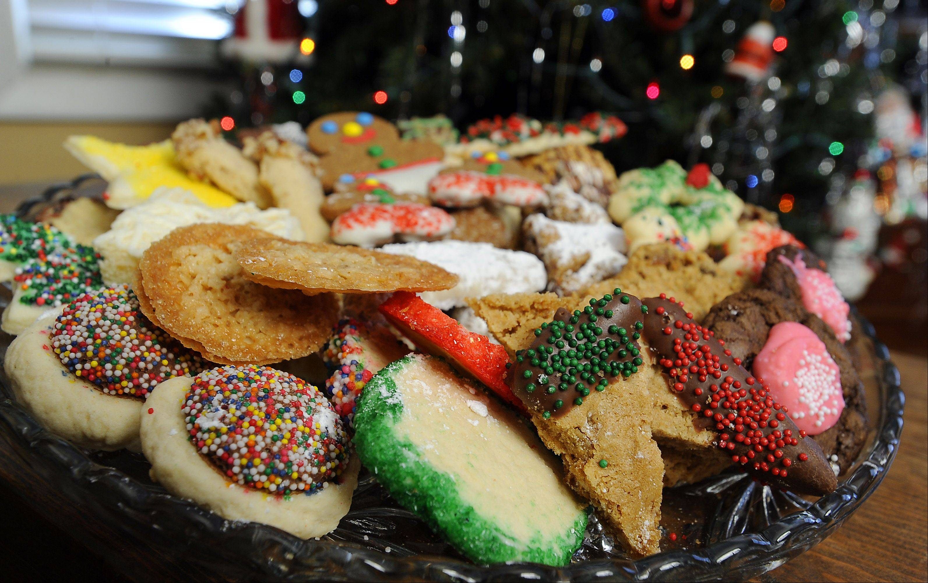 The kitchen of Laverne Hall�s Elk Grove Village home overflows with cookies this time of year. She creates lavish cookie trays to give to family and friends.